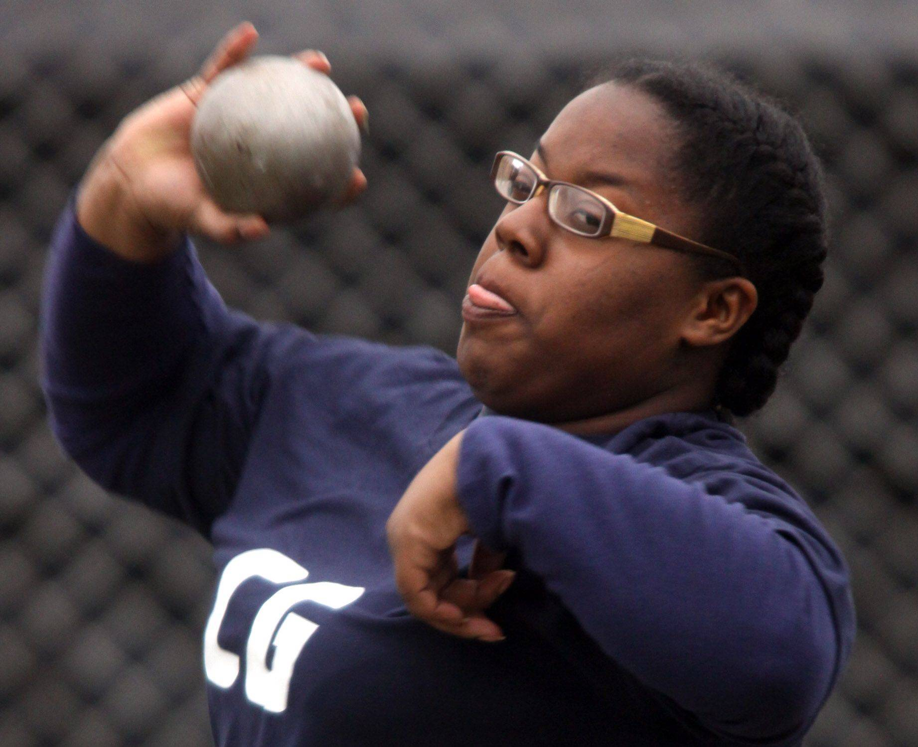 Ketura Taylor of Cary-Grove competes in the shot put during the McHenry County Track and Field Meet at Metcalf Field on the campus of Crystal Lake Central on Wednesday evening.