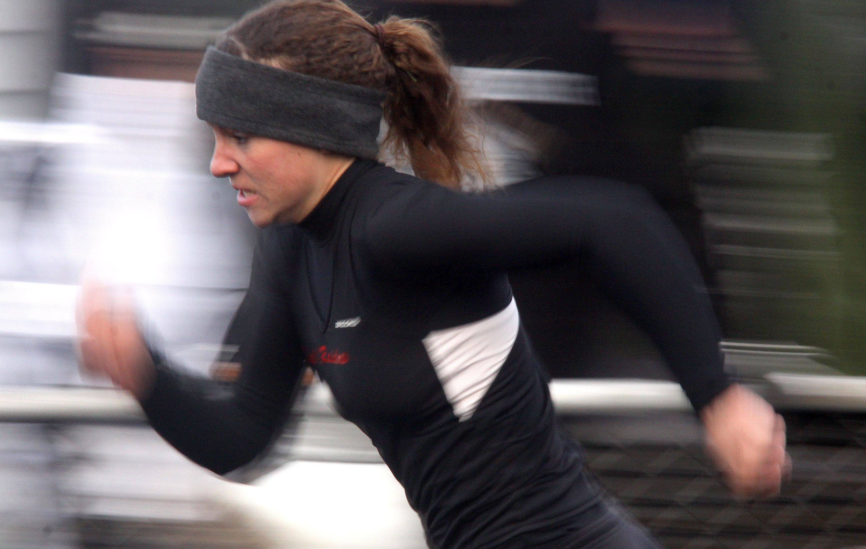 Huntley's Sarah Sheehan speeds through a preliminary heat of the 200-meter dash during the McHenry County Track and Field Meet at Metcalf Field on the campus of Crystal Lake Central on Wednesday evening.