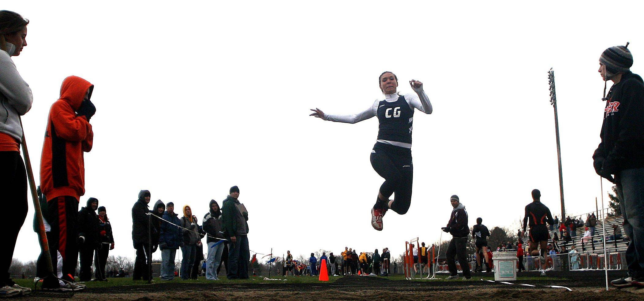 Cary-Grove's Joss Nicholson competes in the triple jump finals during the McHenry County Track and Field Meet at Metcalf Field on the campus of Crystal Lake Central on Wednesday evening.
