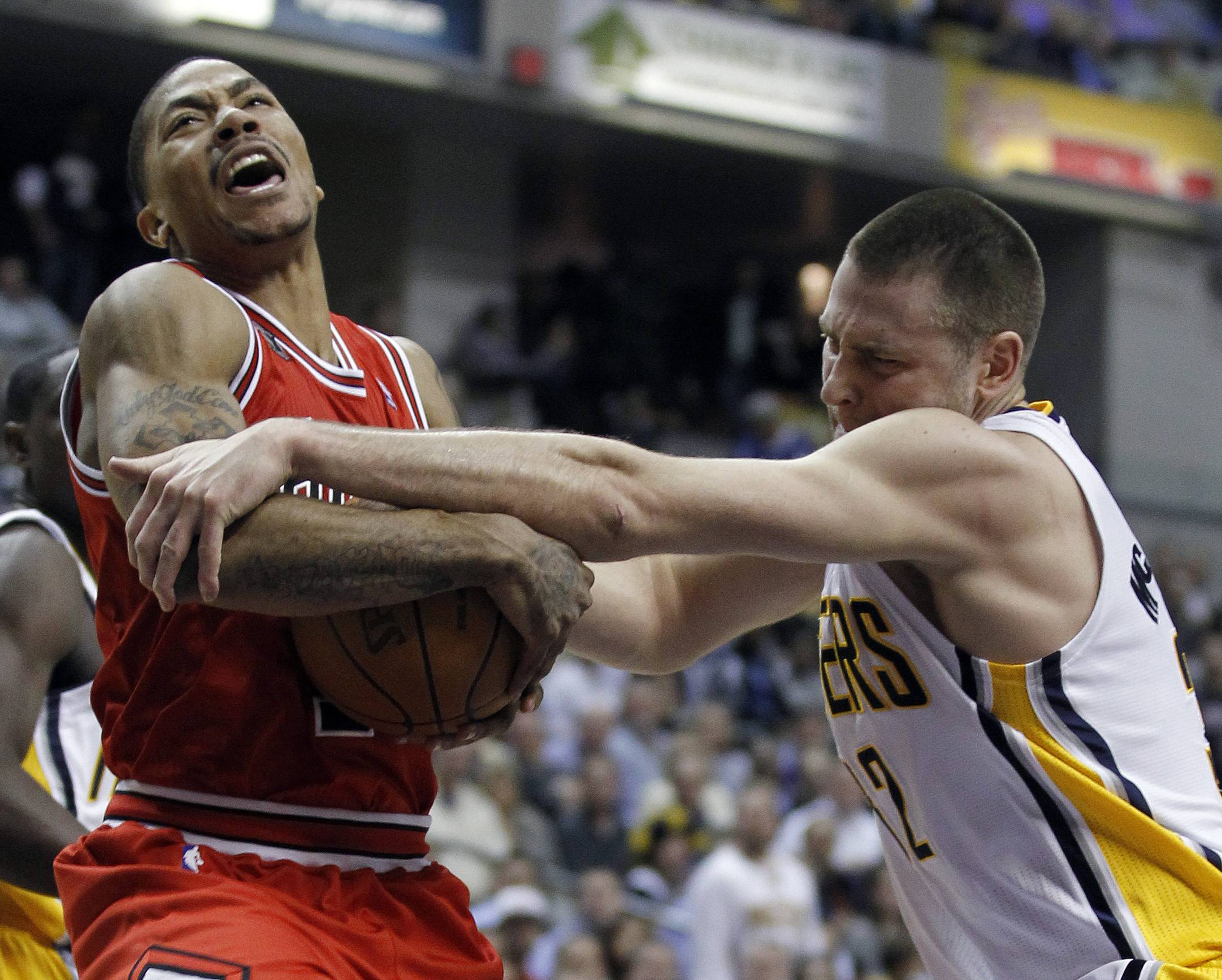 Derrick Rose is fouled by Indiana Pacers' Josh McRoberts (32) during the first half of Game 3 of a first-round NBA basketball series in Indianapolis, Thursday, April 21, 2011.