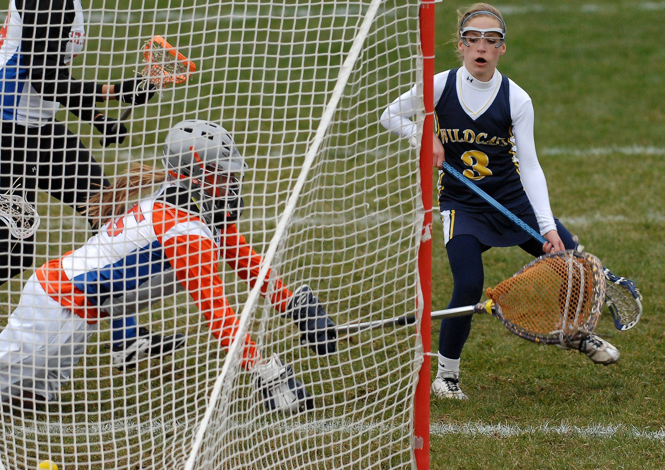 Neuqua Valley's Kelly Leibovitz shoots past St. Charles Co-op goalkeeper Margaret Zimmer during girls lacrosse action in St. Charles Thursday, April 21, 2011.