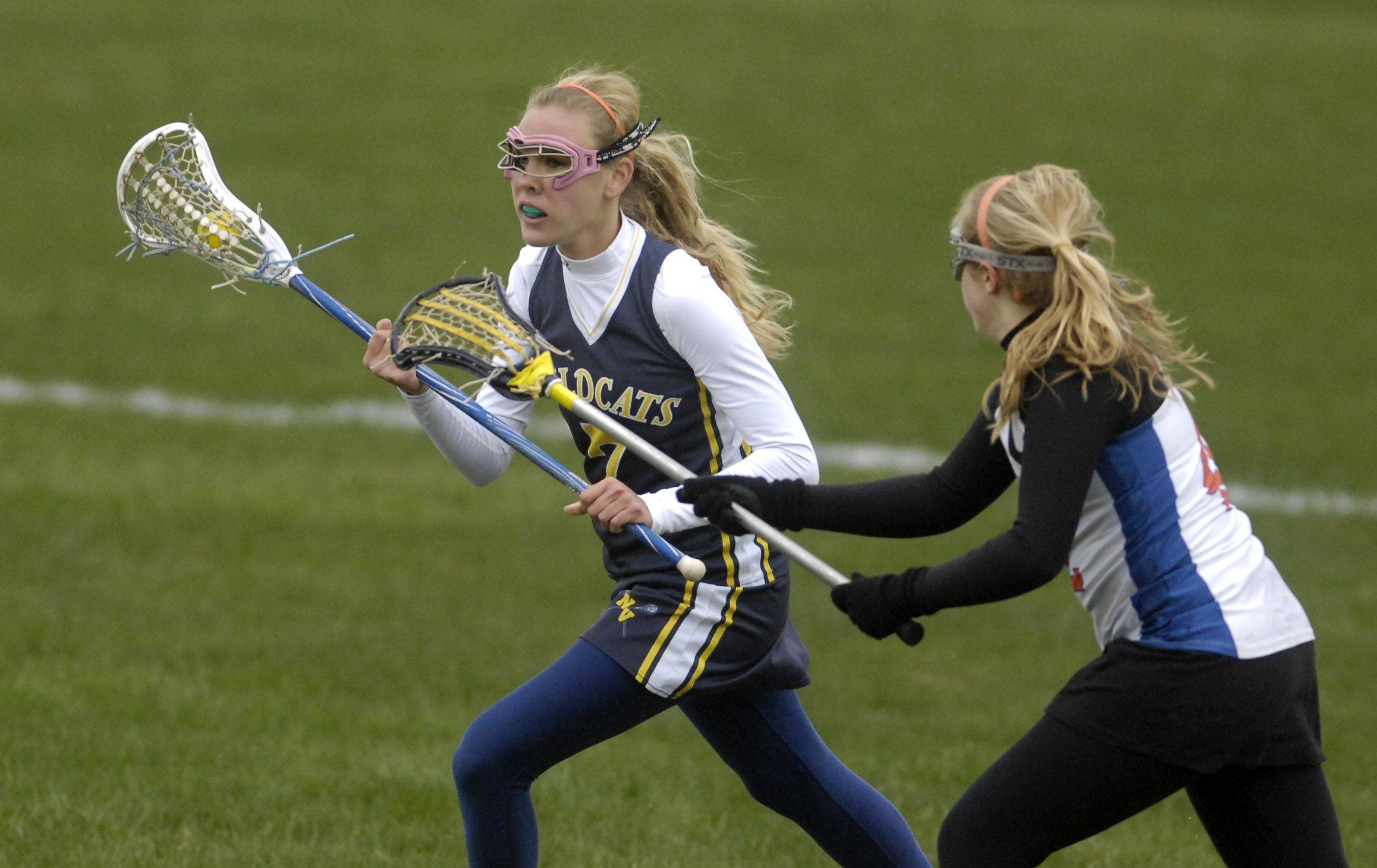 St. Charles Co-op vs. Neuqua Valley in girls lacrosse action in St. Charles Thursday, April 21, 2011.