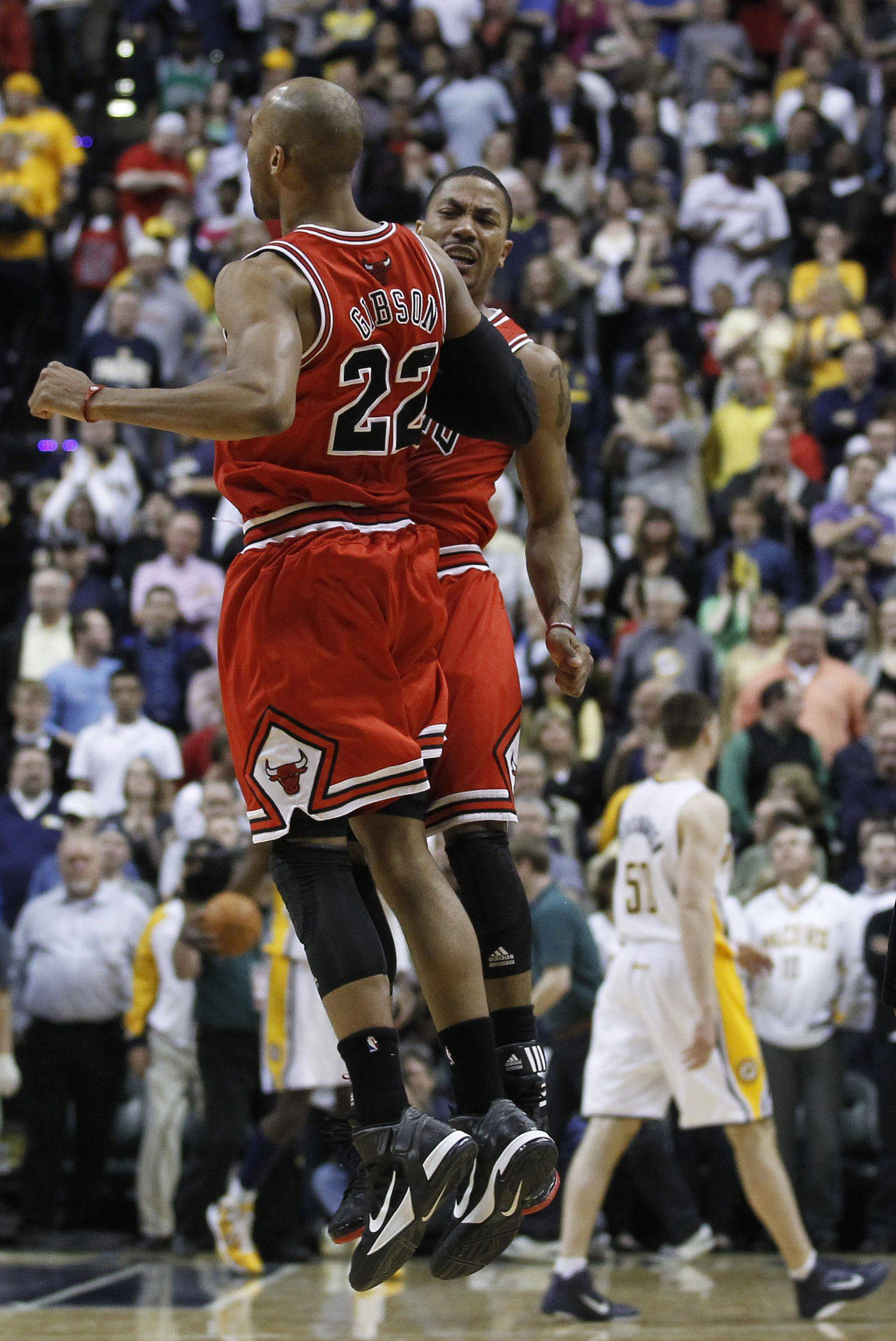 Chicago Bulls' Derrick Rose celebrates with Taj Gibson (22) in the final seconds of Game 3.