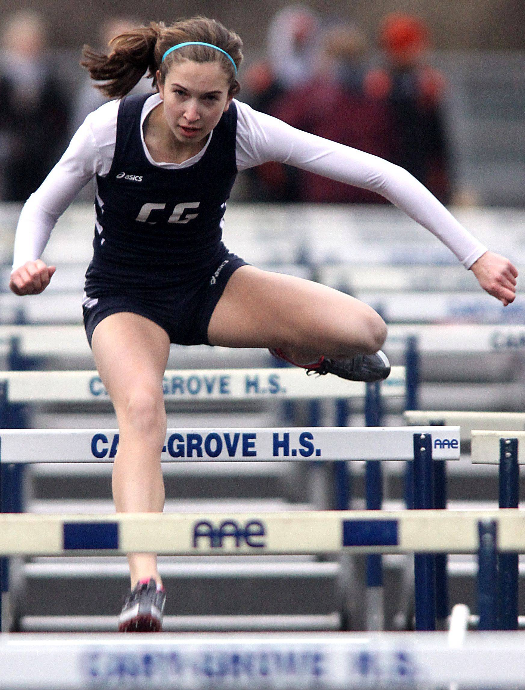 Cary-Grove's Kathie Wollney takes part in the 100-meter hurdles during the McHenry County Track Meet at Al Bohrer Field on the campus of Cary-Grove High School Thursday evening.