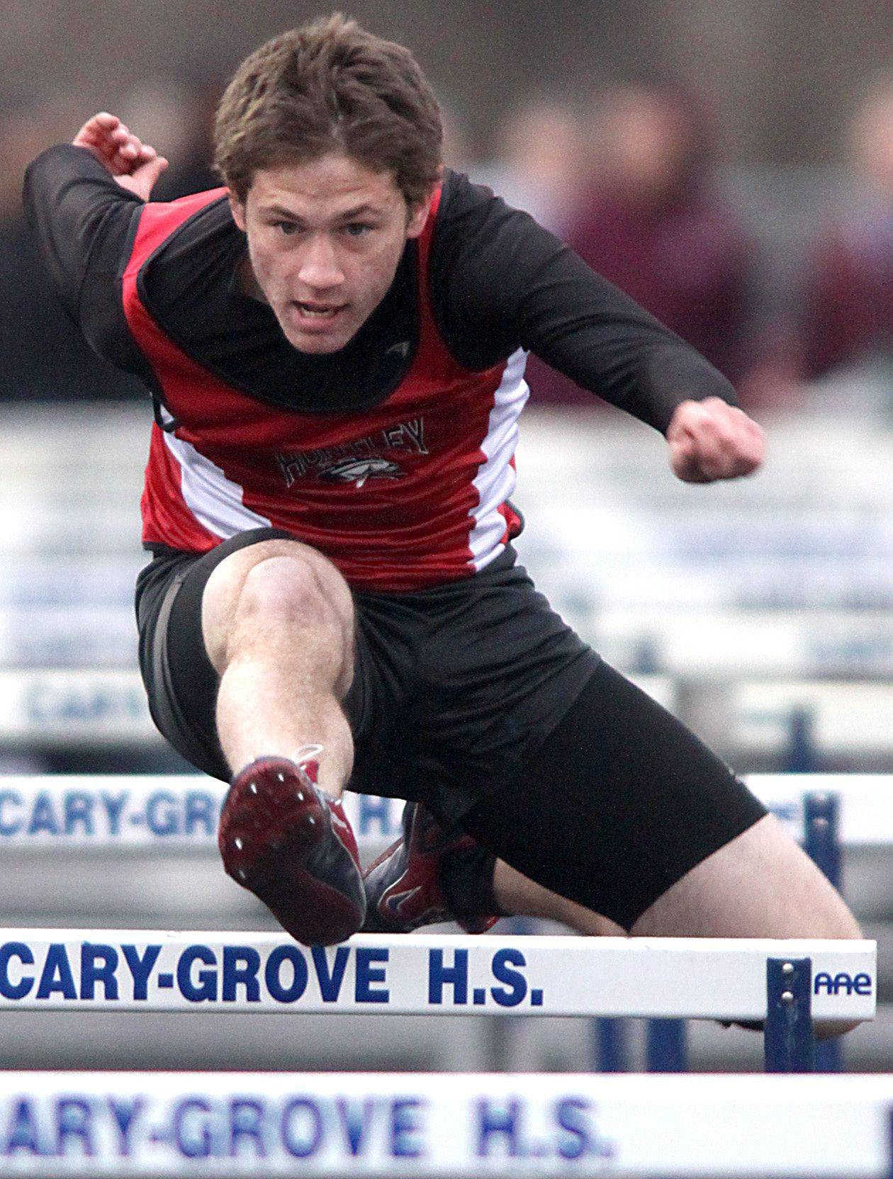 Huntley's Chase Hellinger competes in the 110-meter high hurdles during the McHenry County Track Meet at Al Bohrer Field on the campus of Cary-Grove High School Thursday evening.
