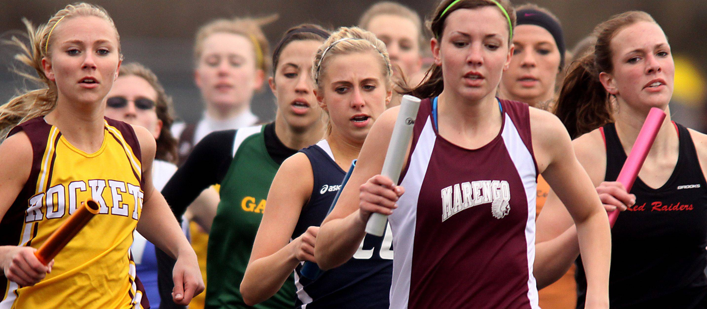 The first runners for each team complete their first lap of the 3200-meter relay during the McHenry County Track Meet at Al Bohrer Field on the campus of Cary-Grove High School Thursday evening.