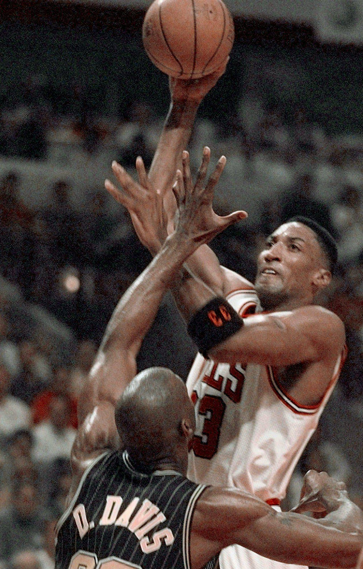 Chicago Bulls' Scottie Pippen (33) shoots over Indiana Pacers' Dale Davis (32) during the second quarter of Game 2 in the Eastern Conference Finals Tuesday, May 19, 1998, in Chicago.