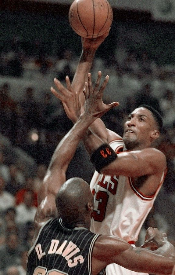 08db3936057 Chicago Bulls  Scottie Pippen (33) shoots over Indiana Pacers  Dale Davis (