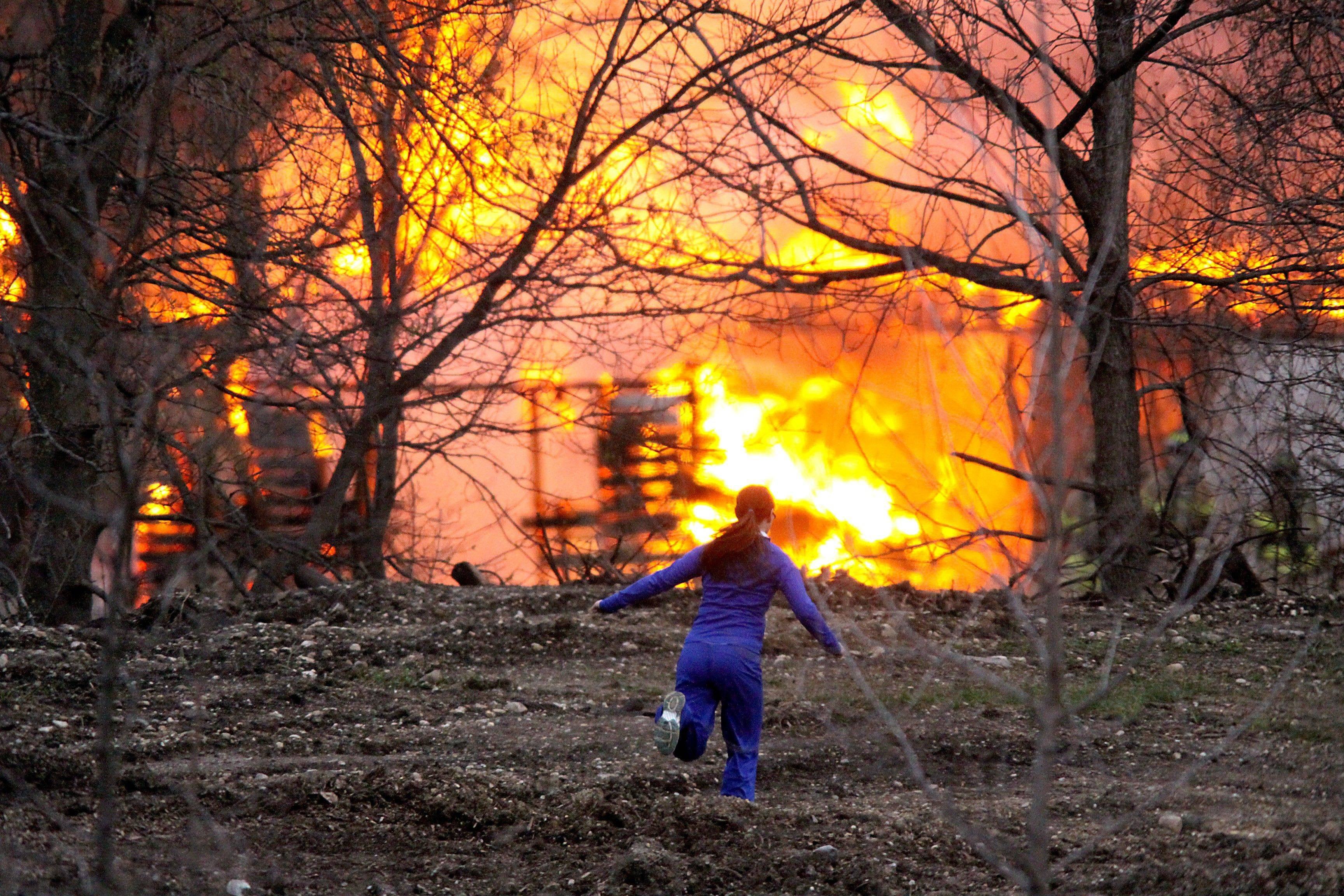 Onlookers watch a fire burn near Huntley on Thursday night.