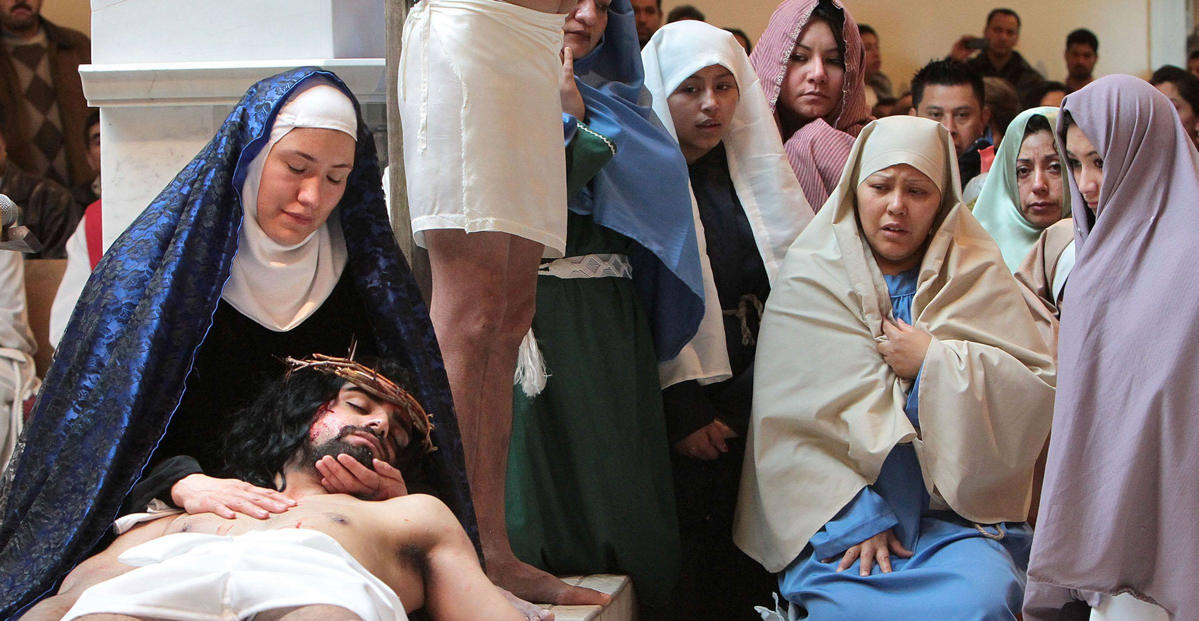 Andres Colon, 21, plays the roll of Jesus and 30-year-old Elizabeth Rivera plays the roll of Mary, both of Waukegan, as the parishioners of Most Blessed Trinity Parish in Waukegan held a Living Stations of the Cross for Good Friday.