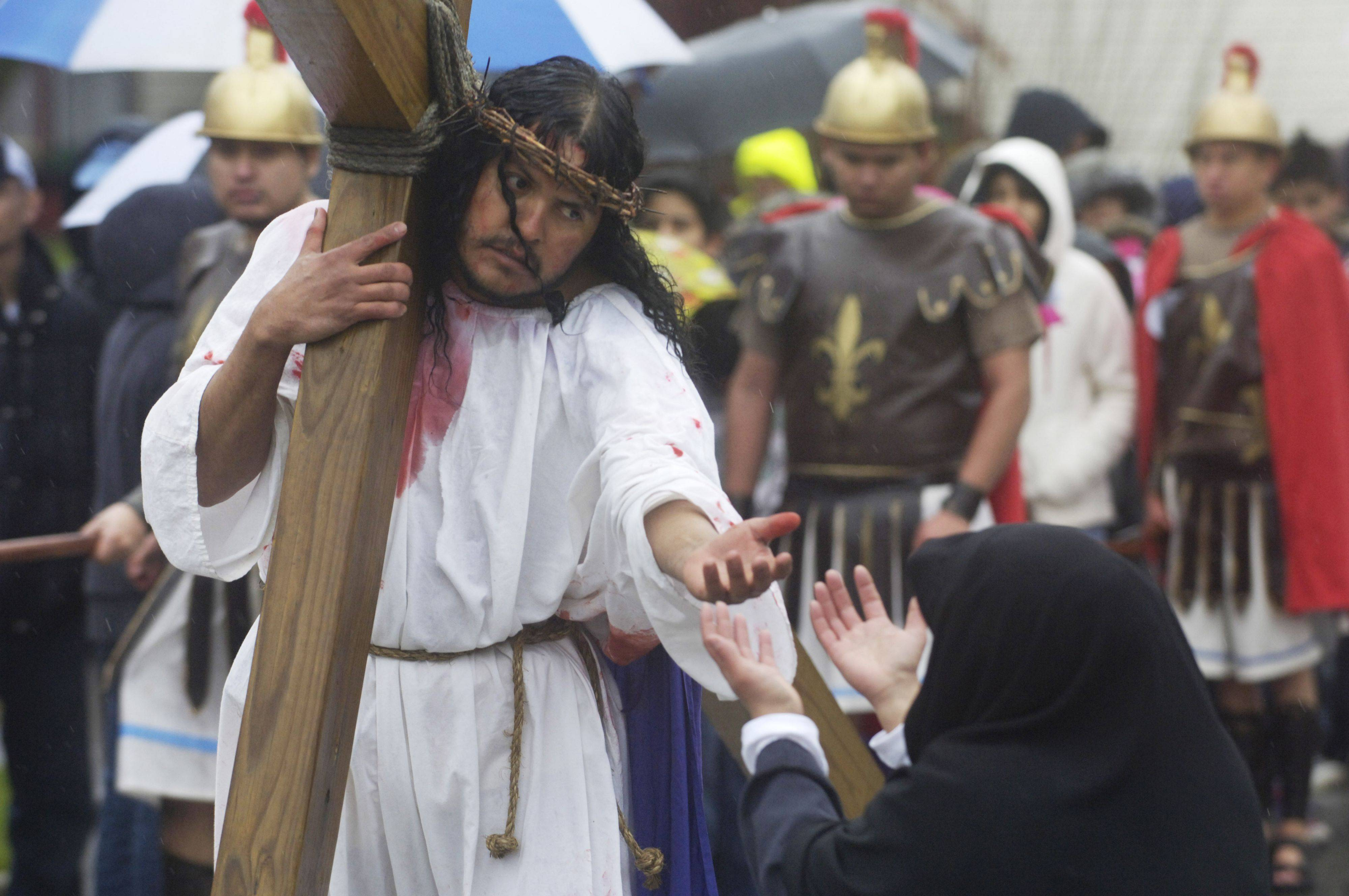 """Jesus meets his Mother"" during the Good Friday procession from St. Thomas Church to Mission San Juan Diego in Arlington Heights."