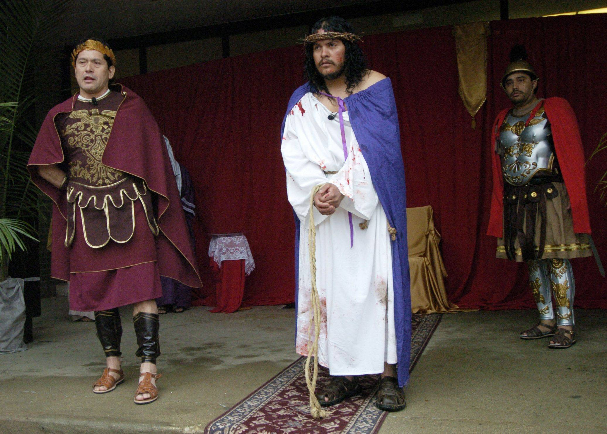 Pontius Pilate, played by Ciro Torres, condemns Jesus, played by Omar Parma, during the Good Friday procession from St. Thomas Church to Mission San Juan Diego in Arlington Heights.