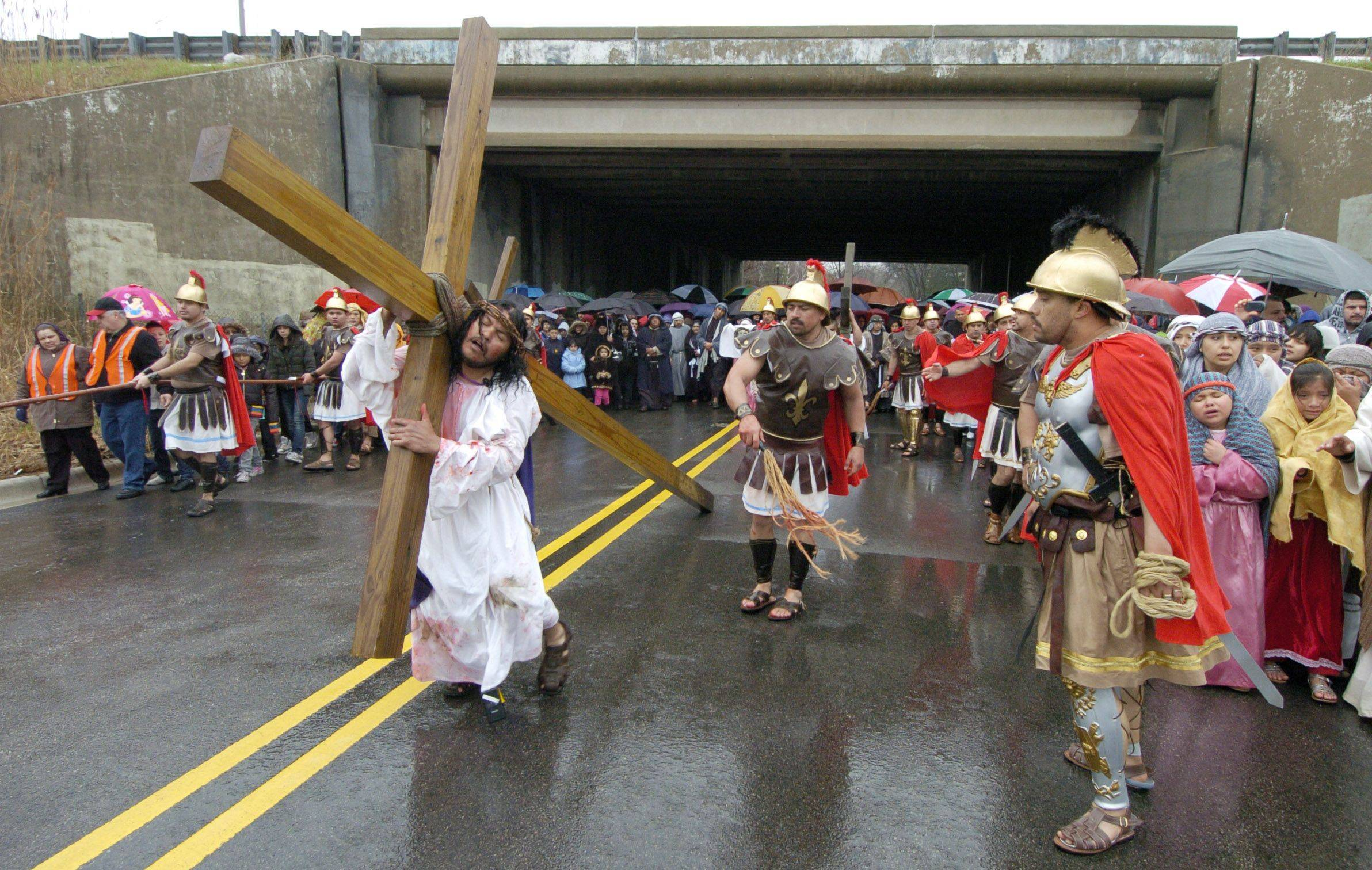 The Good Friday procession from St. Thomas Church to Mission San Juan Diego passes under Route 53 in Arlington Heights.