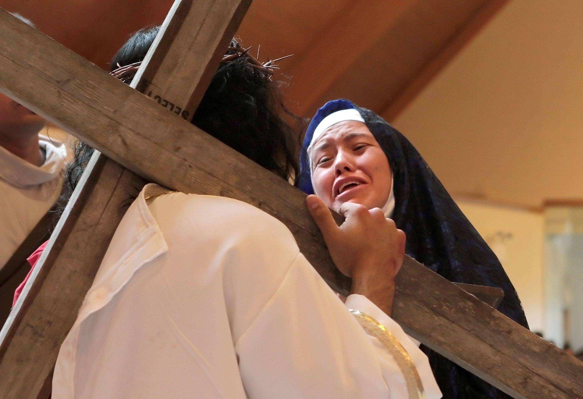 21 year old Andres Colon plays the roll of Jesus and 30 year old Elizabeth Rivera plays the roll of Mary, both of Waukegan, as the parishioners of Most Blessed Trinity Parish in Waukegan held a Living Stations of the Cross for Good Friday.