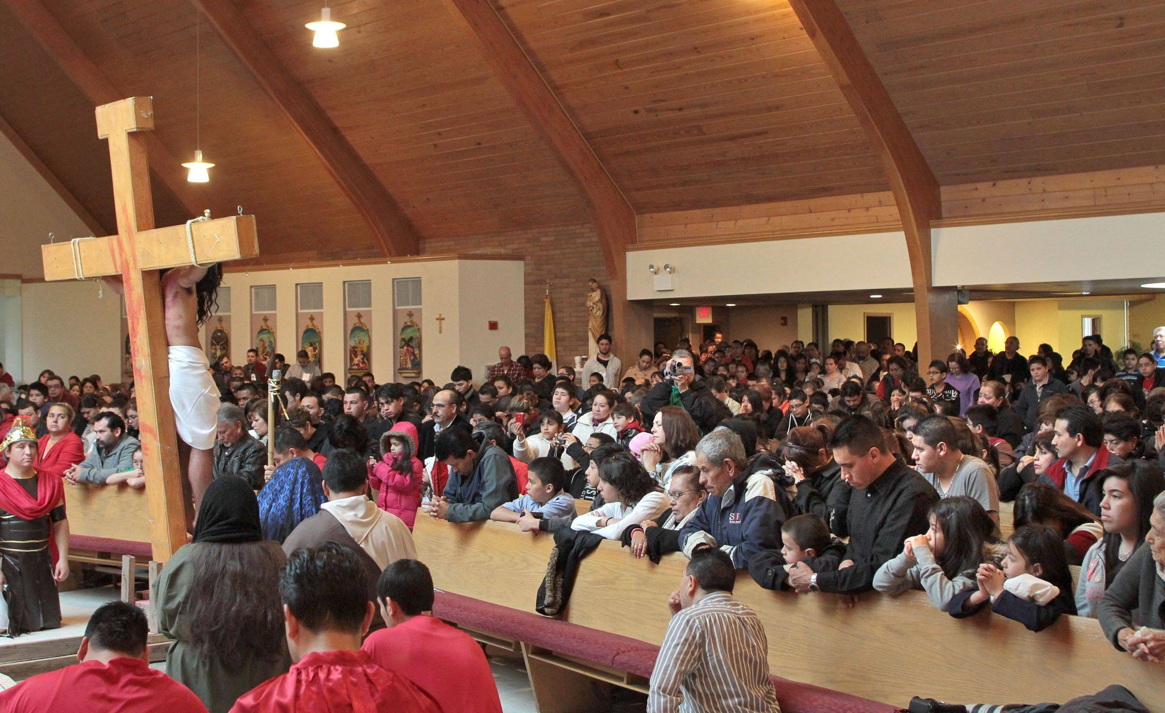 A standing-room-only crowd watches as the Most Blessed Trinity Parish in Waukegan performed the Living Stations of the Cross for Good Friday.