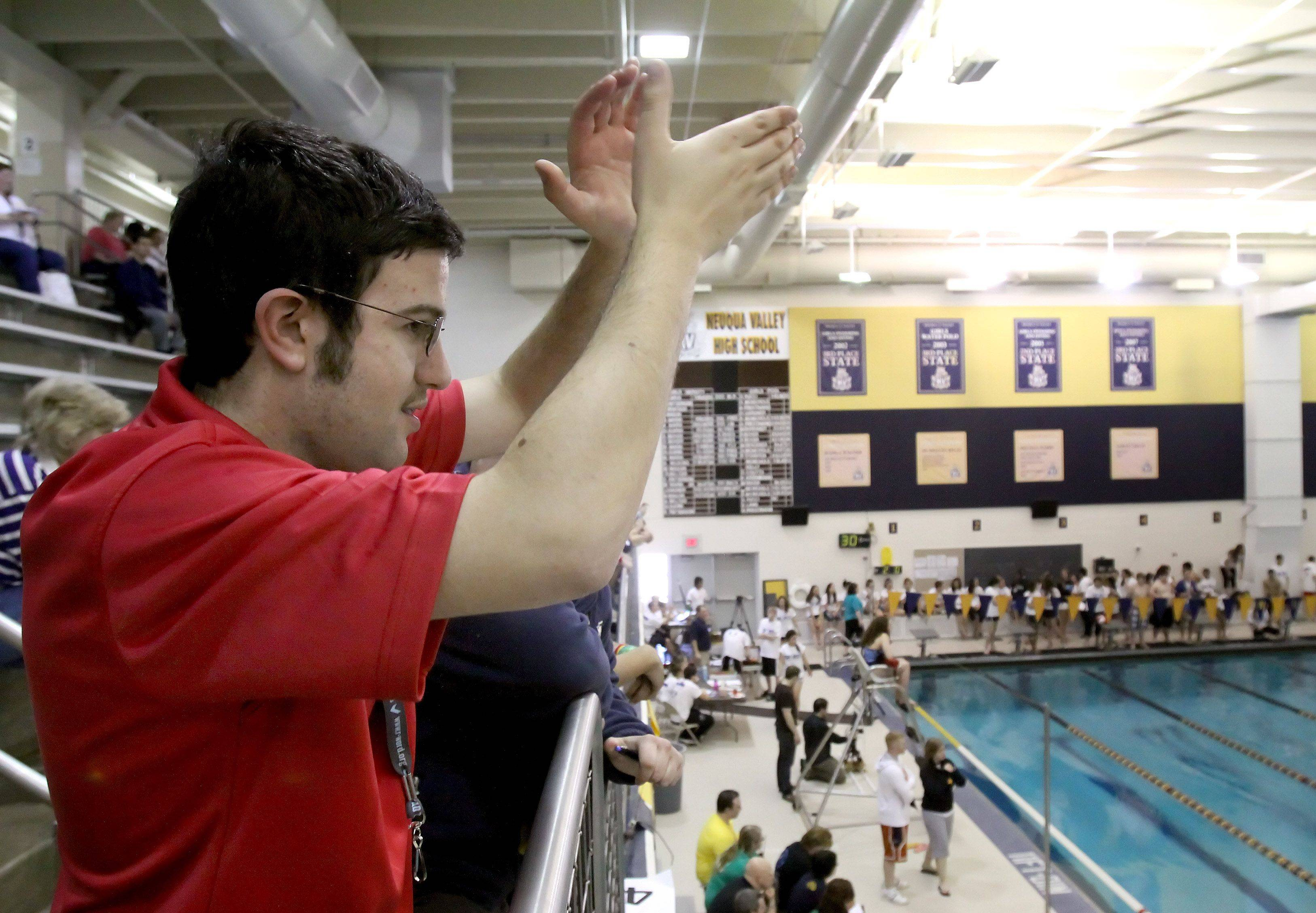 "Jordan Schubert, an autistic senior at Neuqua Valley High School, hosts a Special Olympics swim meet in Naperville, where he also campaigned for people to stop using the ""R-word."""