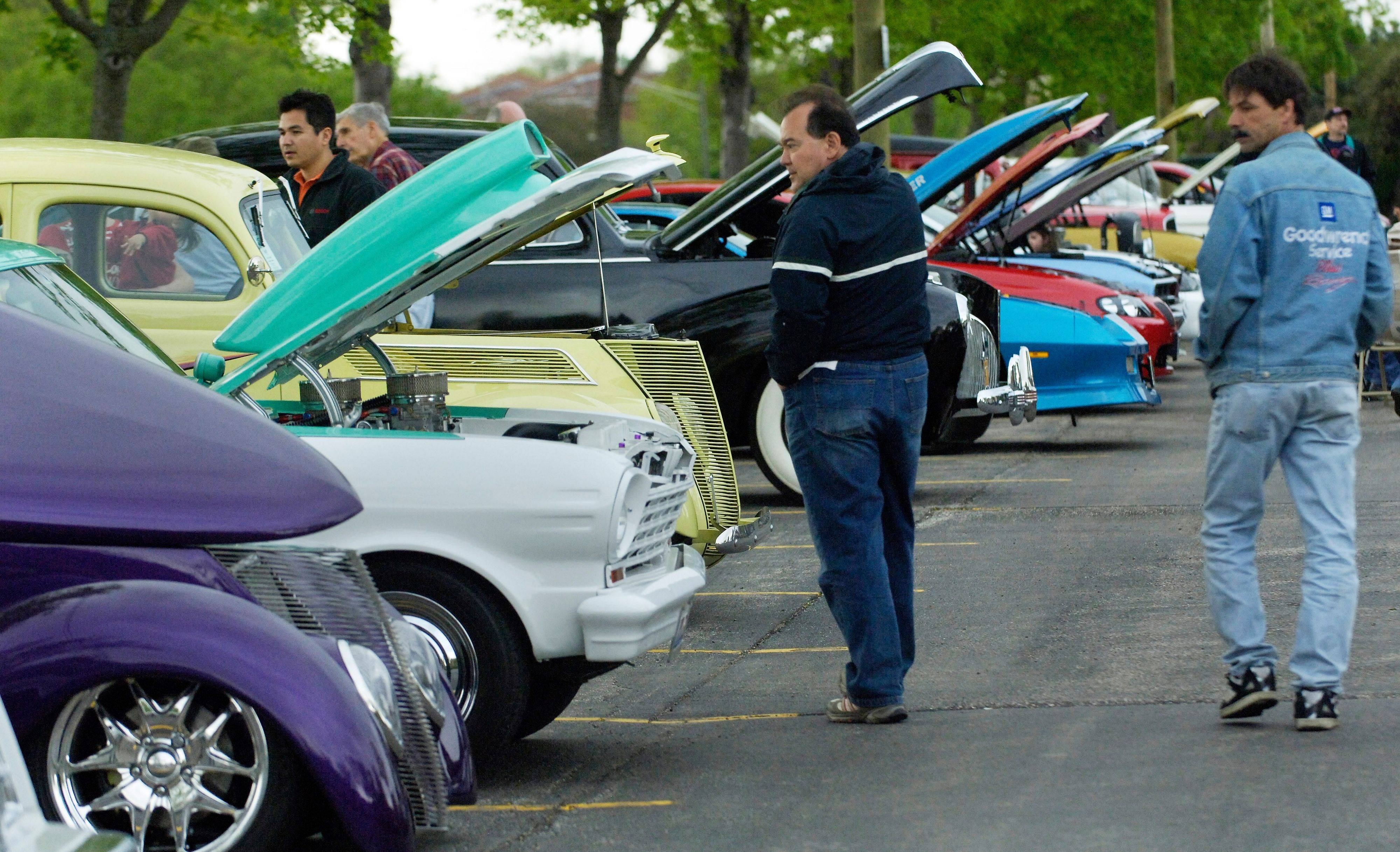Antique cars are on display at the Metra station parking lot for BluesMobile Cruise Night.