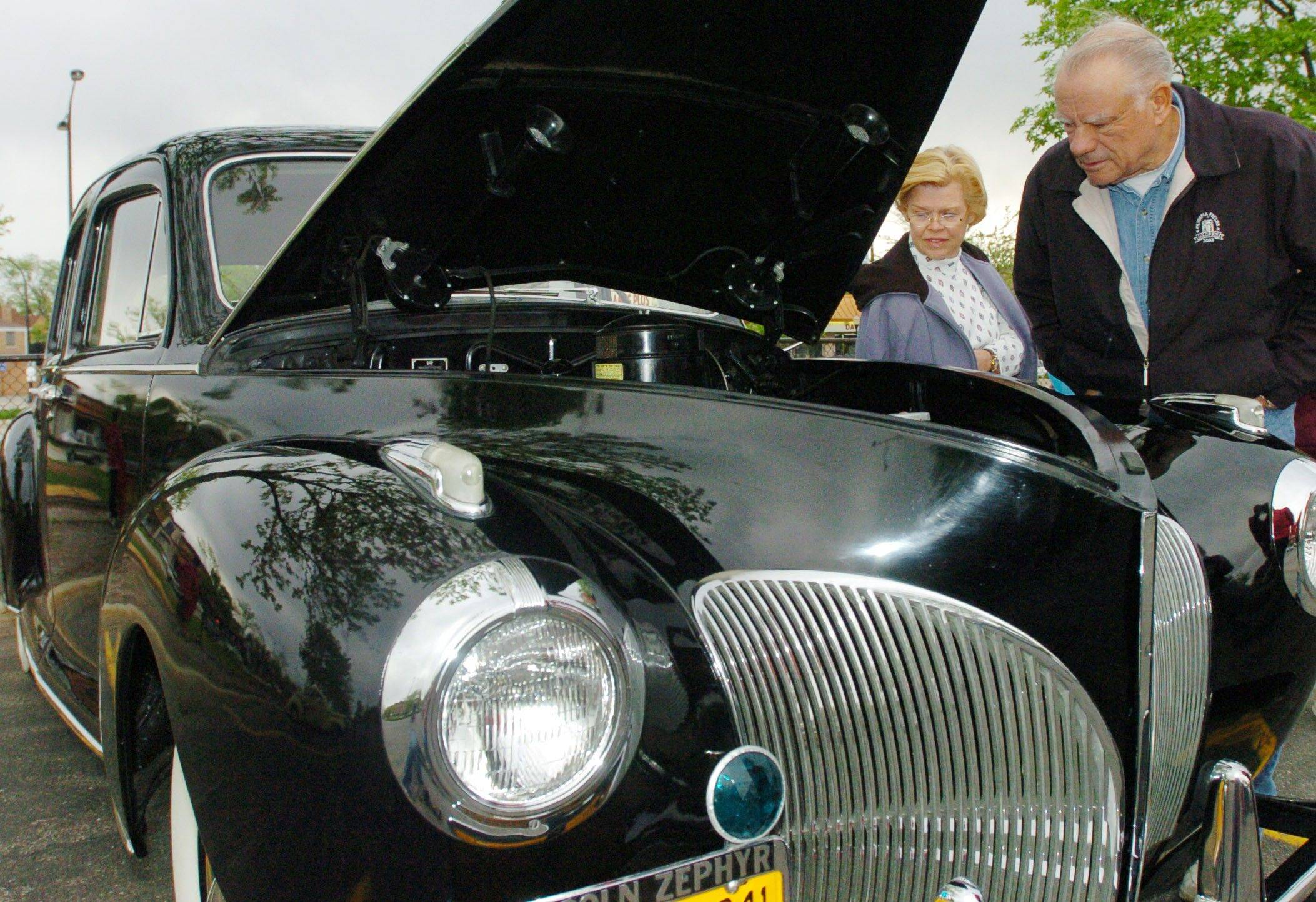 In 2008, two visitors stop to look at a 1941 Lincoln Zephyr belonging to Don Reinhardt of Chicago.