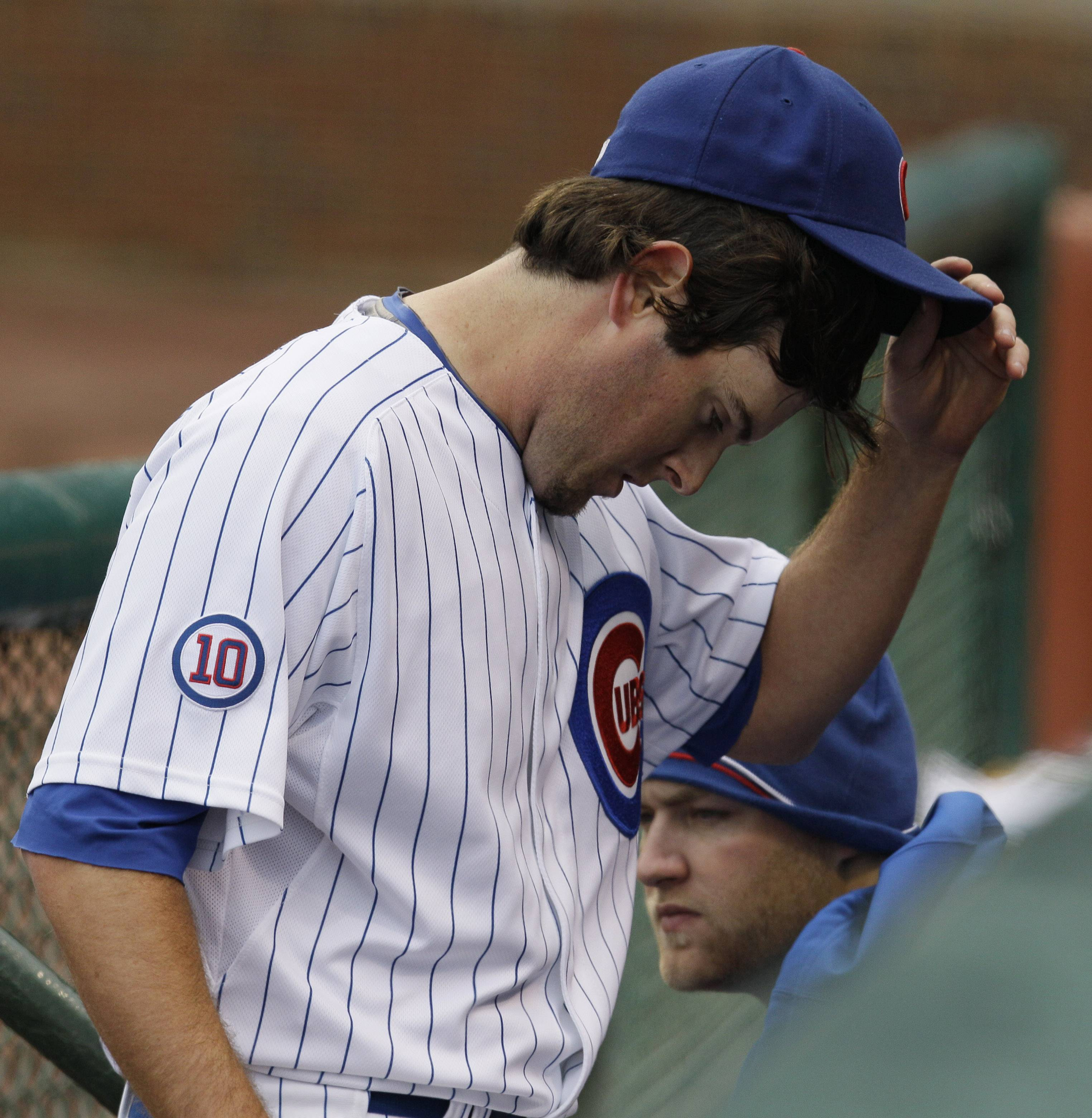 Casey Coleman reacts after he relieved by manager Mike Quade during the third inning of a baseball game against the Los Angeles Dodgers on Friday at Wrigley Field.