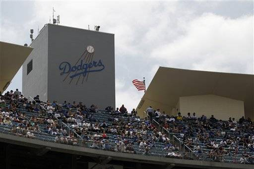 Fans sit in the top deck of Dodger Stadium during a baseball game between the Los Angeles Dodgers and Atlanta Braves, Thursday.