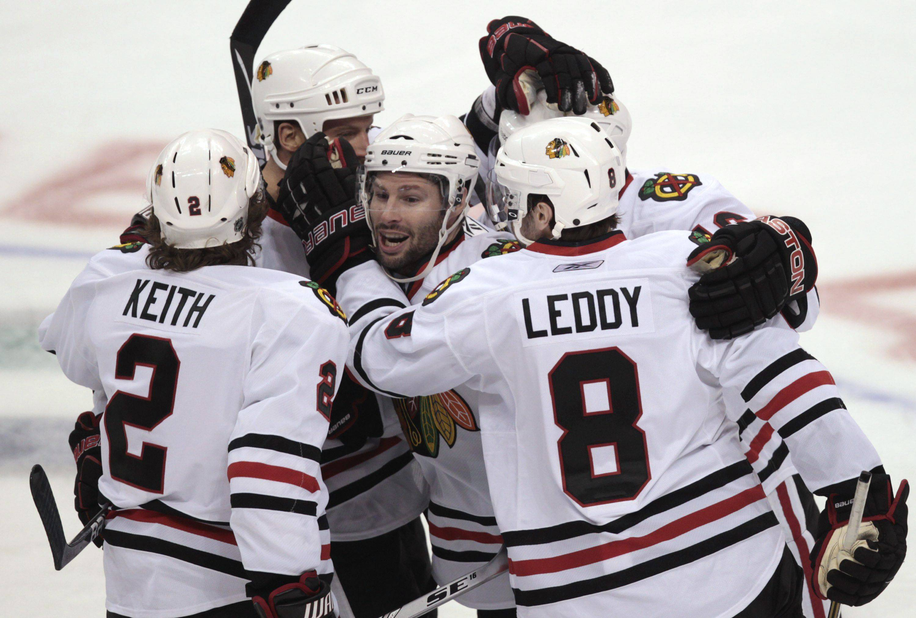 Chicago Blackhawks' Duncan Keith, Ryan Johnson, Troy Brouwer, Marcus Kruger, and Nick Leddy, from left, celebrate Keith's goal.