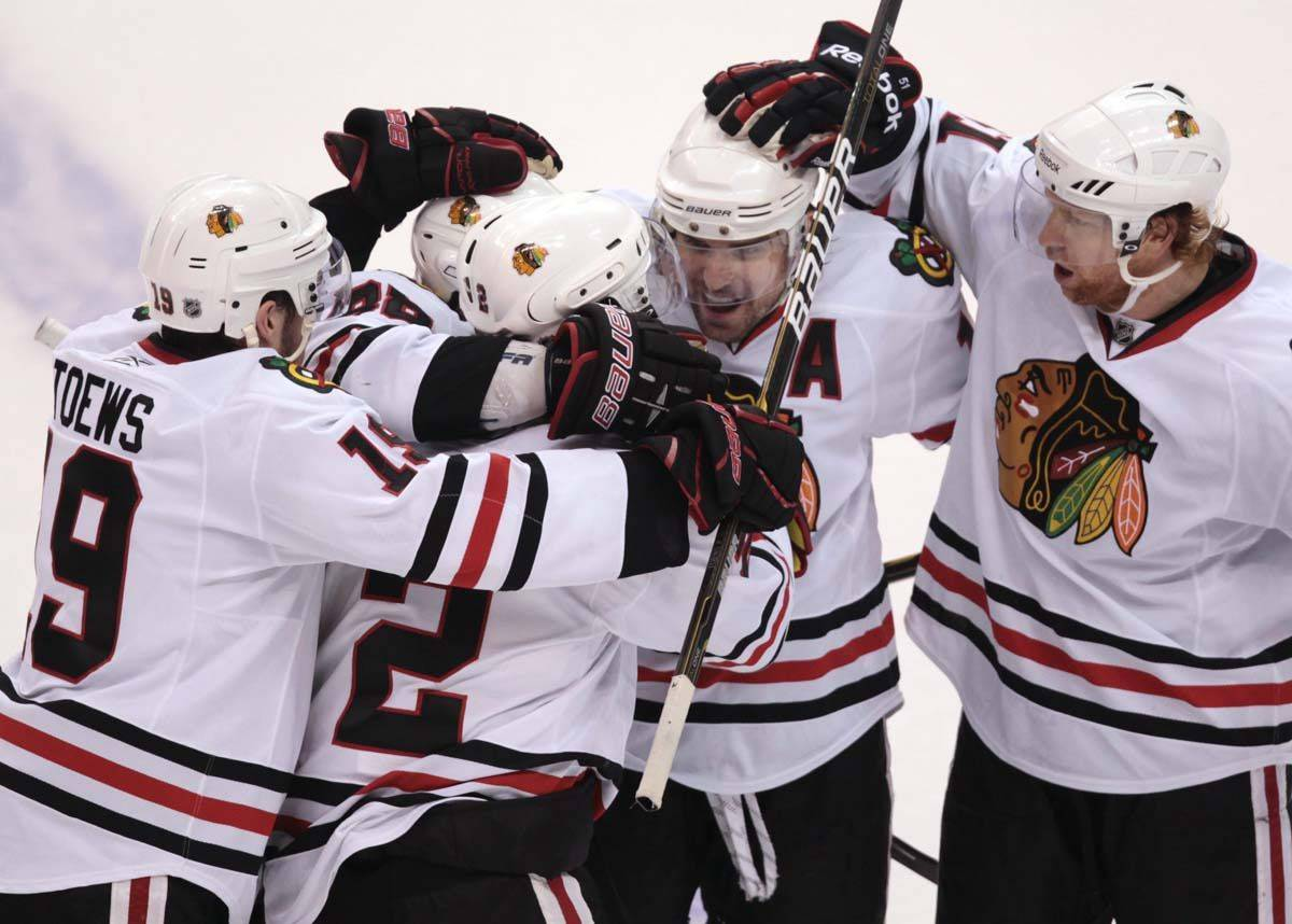 From left to right, Chicago Blackhawks' Jonathan Toews, Patrick Kane, Duncan Keith, Patrick Sharp and Brian Campbell celebrate Keith's goal.
