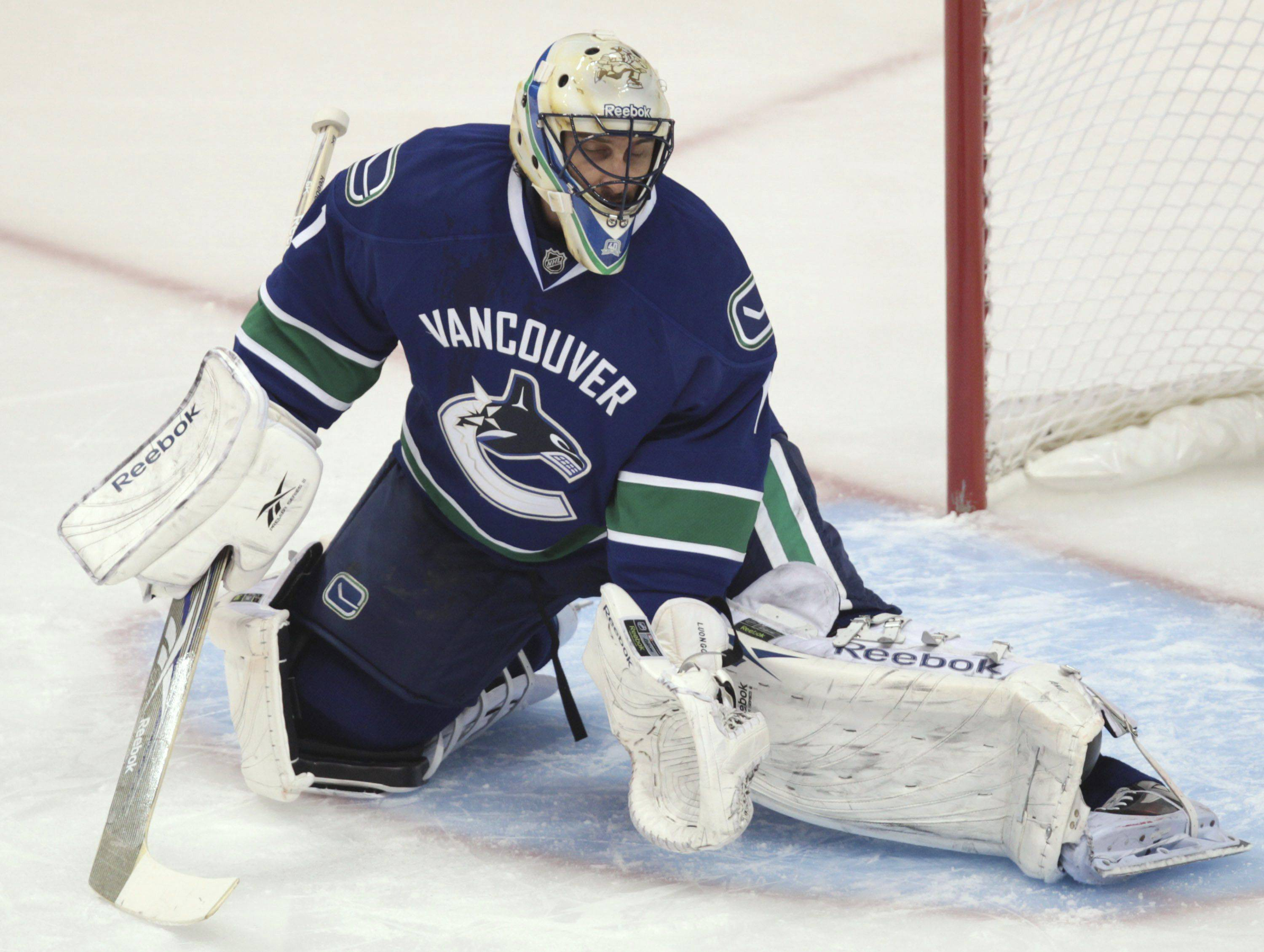 Vancouver Canucks' Roberto Luongo reacts after allowing a goal by Chicago Blackhawks' Marian Hossa.