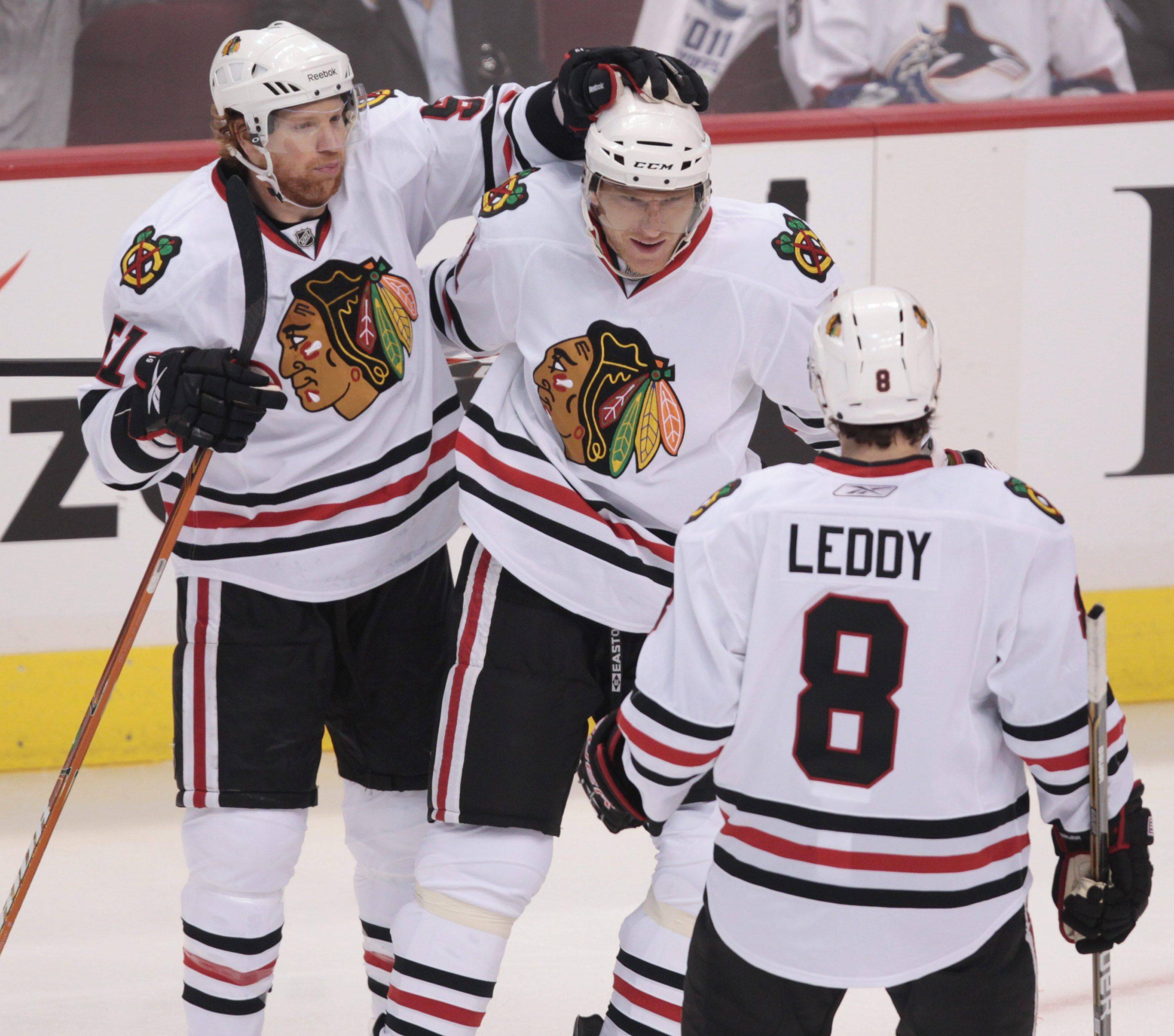 Chicago Blackhawks' Brian Campbell, Marian Hossa, of Slovakia, and Nick Leddy, from left, celebrate Hossa's goal .