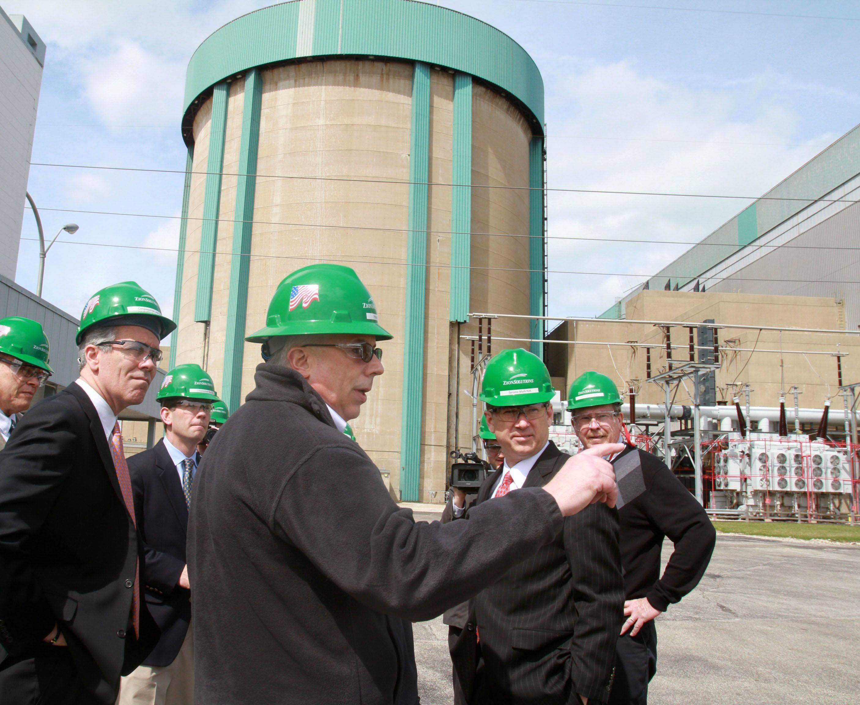George LeClaire/gleclaire@dailyherald.comPatrick Daly with Zioin Solutions, center foreground, gives U.S. Representative Joe Walsh left to right, U.S. Representative Robert Dold and U.S. Senator Mark Kirk, right a tour of the Zion Nuclear Power Plant on Saturday, April 23. The plant is closed and currently used to cool the spent nuclear fuel.
