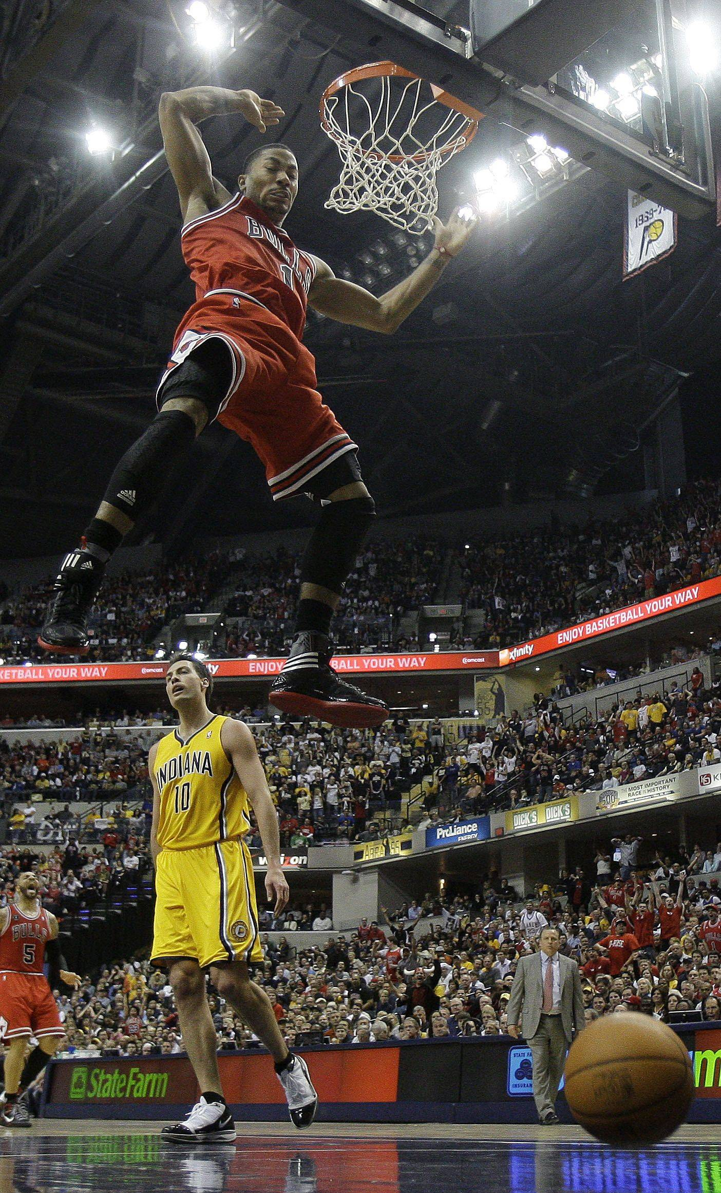 Chicago Bulls' Derrick Rose (1) reacts after a dunk during the first half of Game 4 of a first-round NBA basketball series in Indianapolis, Saturday, April 23, 2011. Indiana Pacers' Jeff Foster (10) is at left.