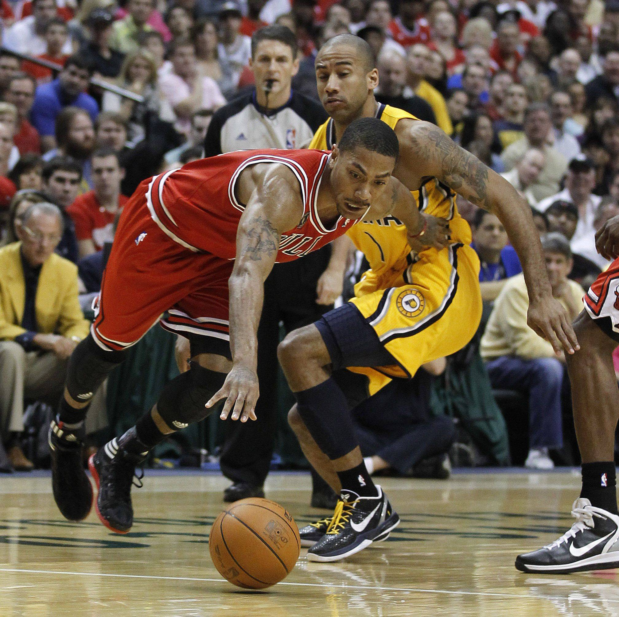 Chicago Bulls' Derrick Rose, left, drives past Indiana Pacers' Dahntay Jones during the first half of Game 4 of a first-round NBA basketball series, Saturday, April 23, 2011, in Indianapolis.
