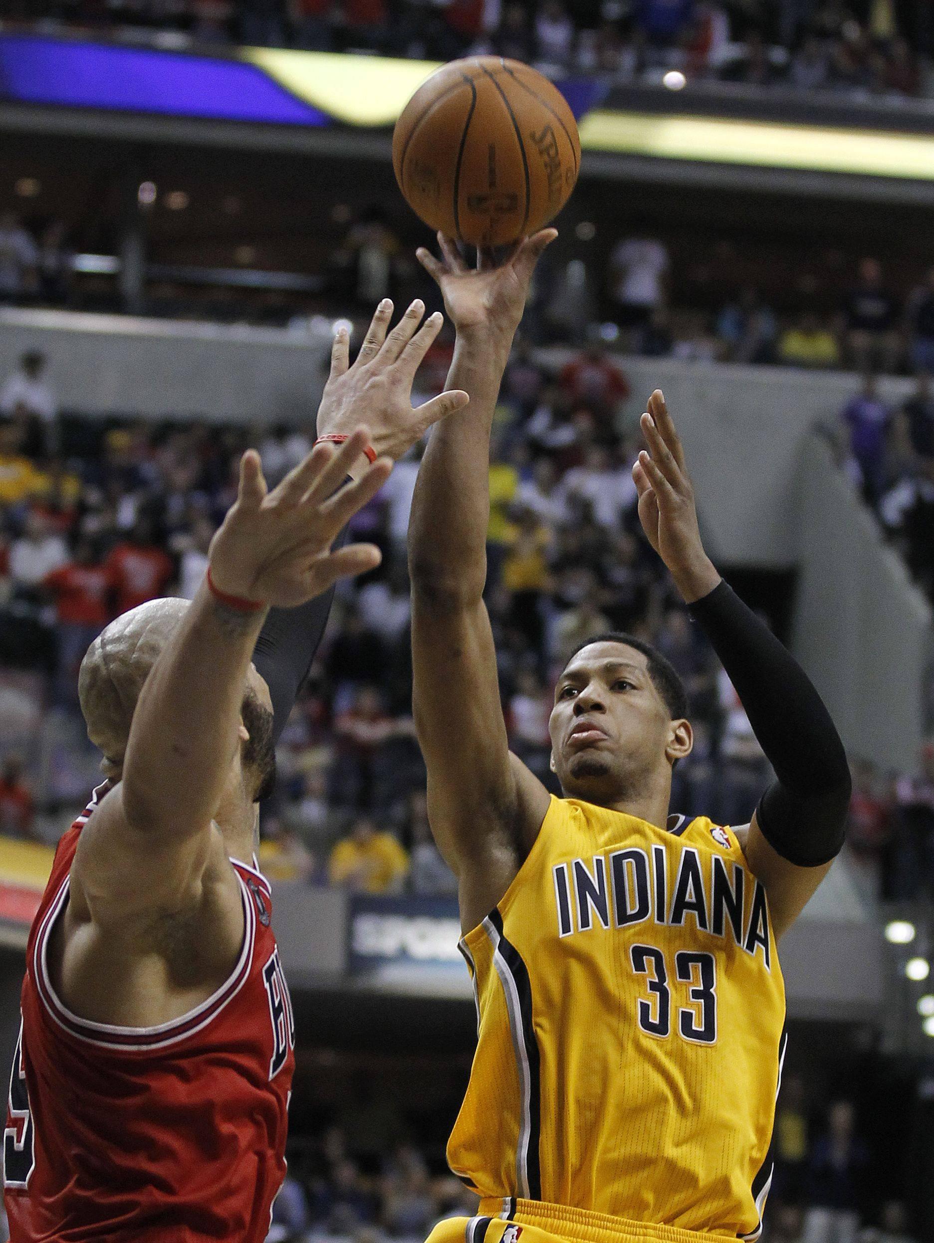 Indiana Pacers' Danny Granger, right, puts up a shot against Chicago Bulls' Carlos Boozer during the second half of Game 4 of a first-round NBA basketball series in Indianapolis, Saturday, April 23, 2011. Indianan won 89-84.