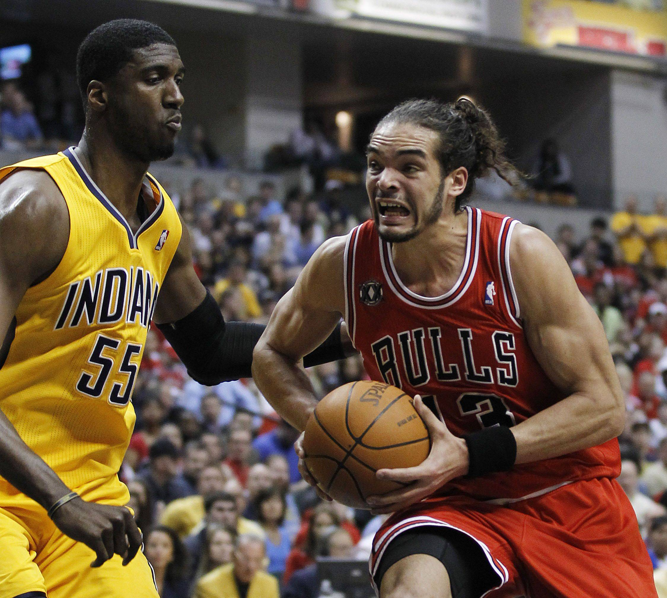 Chicago Bulls' Joakim Noah, right, drives to the basket against Indiana Pacers' Roy Hibbert during the first half of Game 4 of a first-round NBA basketball series in Indianapolis, Saturday, April 23, 2011.