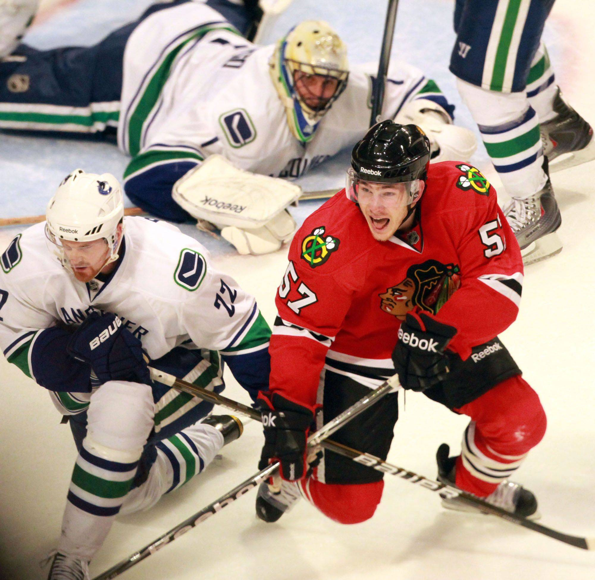 Smith's goal in overtime gives Hawks one last shot