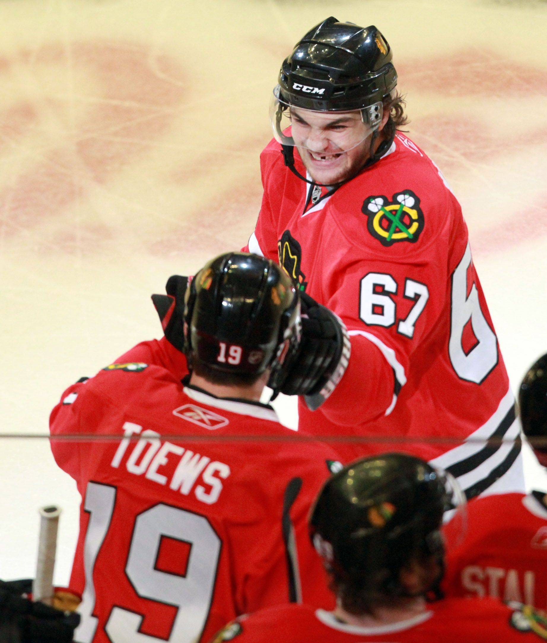 Michael Frolik celebrates his penalty-shot goal early in the third period with Jonathan Toews.
