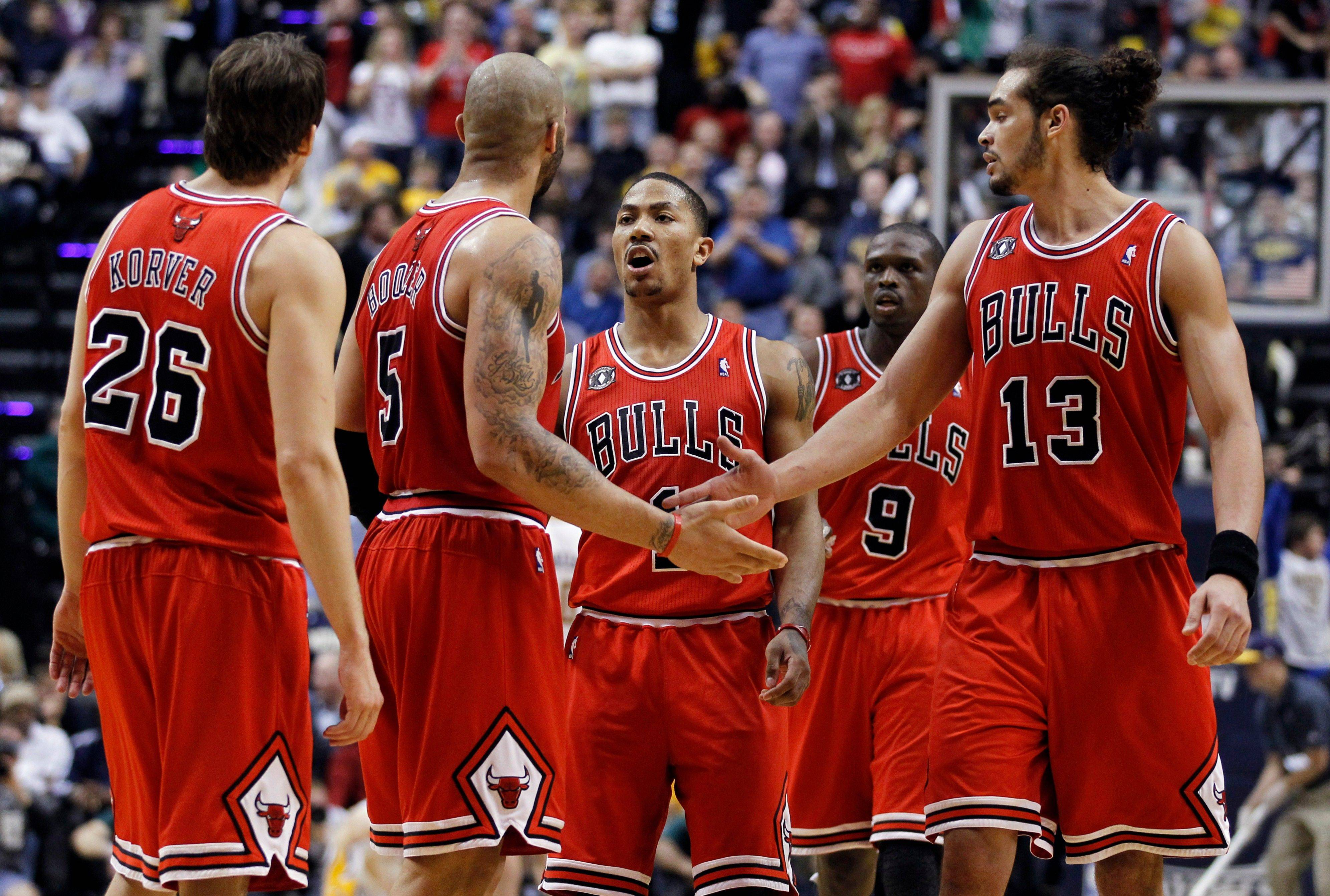 Kyle Korver, from left, Carlos Boozer, Derrick Rose, Luol Deng and Joakim Noah react during Thursday's Game 3 victory over the Pacers at Indiana.