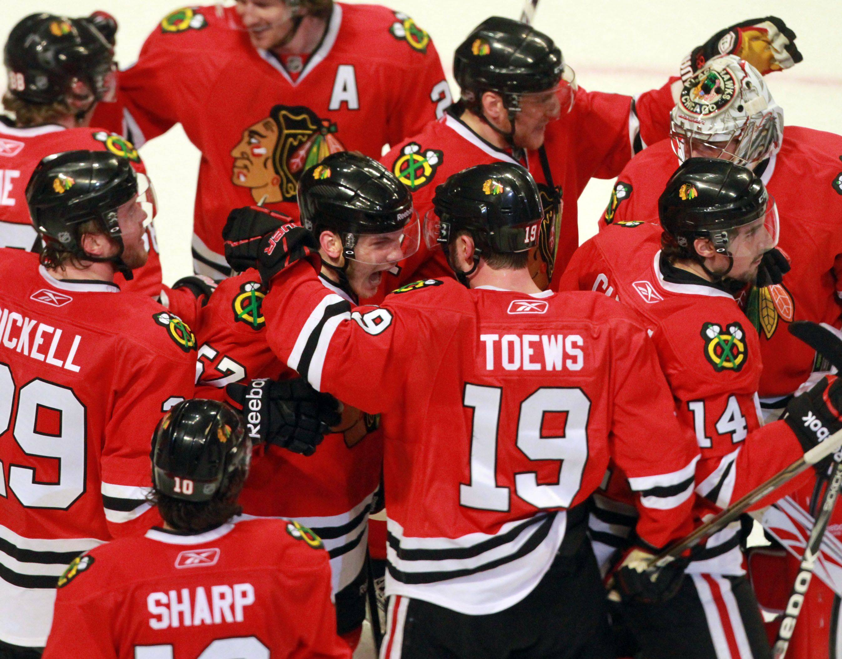 Chicago Blackhawks winning in overtime 4-3 against the Vancouver Canucks in game 6 of the Stanley Cup quarterfinals at the United Center in Chicago on Sunday.