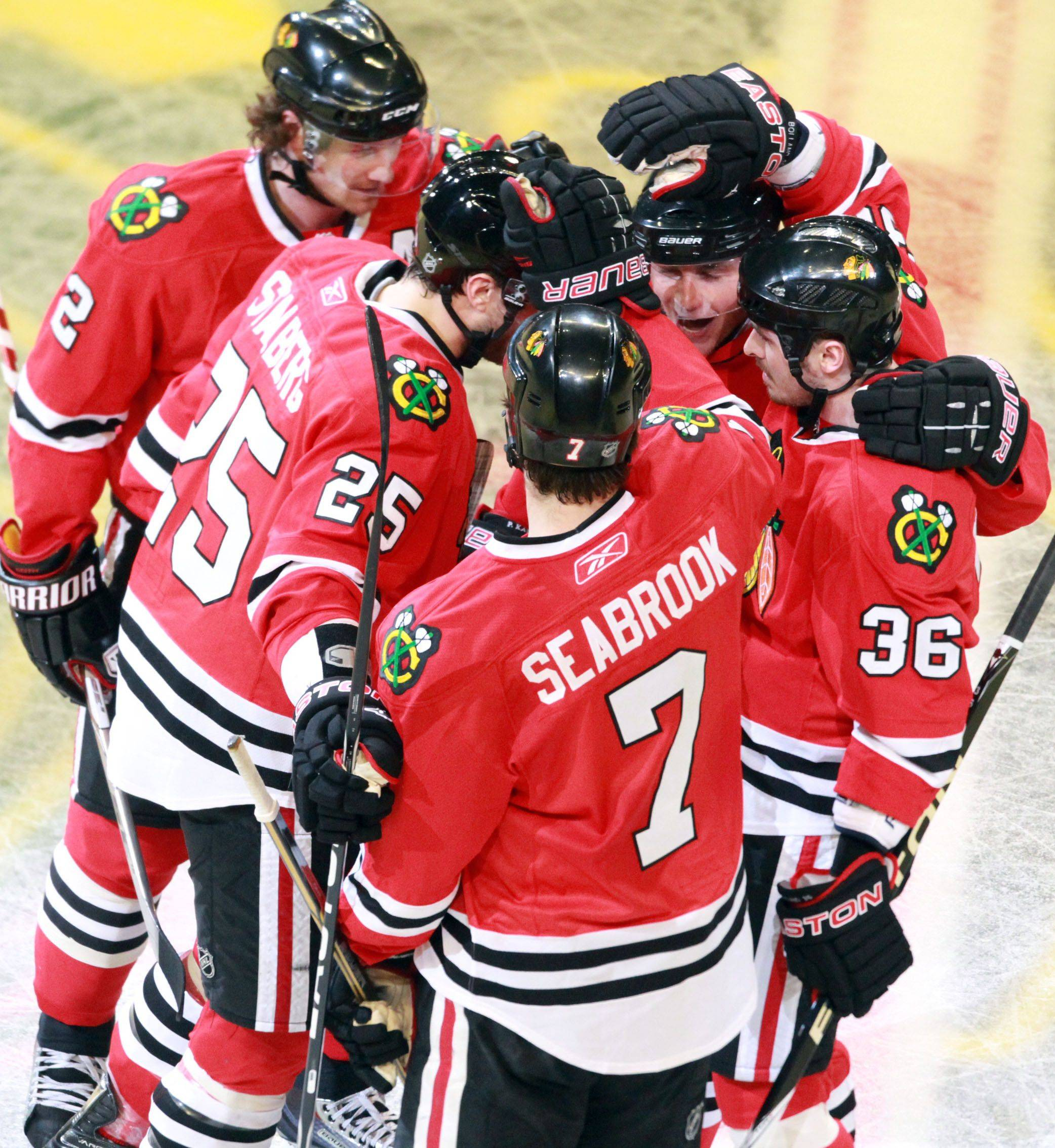 Chicago Blackhawks celebrate penalty goal by Michael Frolik against Vancouver Canucks in game 6 of the Stanley Cup quarterfinals at the United Center in Chicago on Sunday.