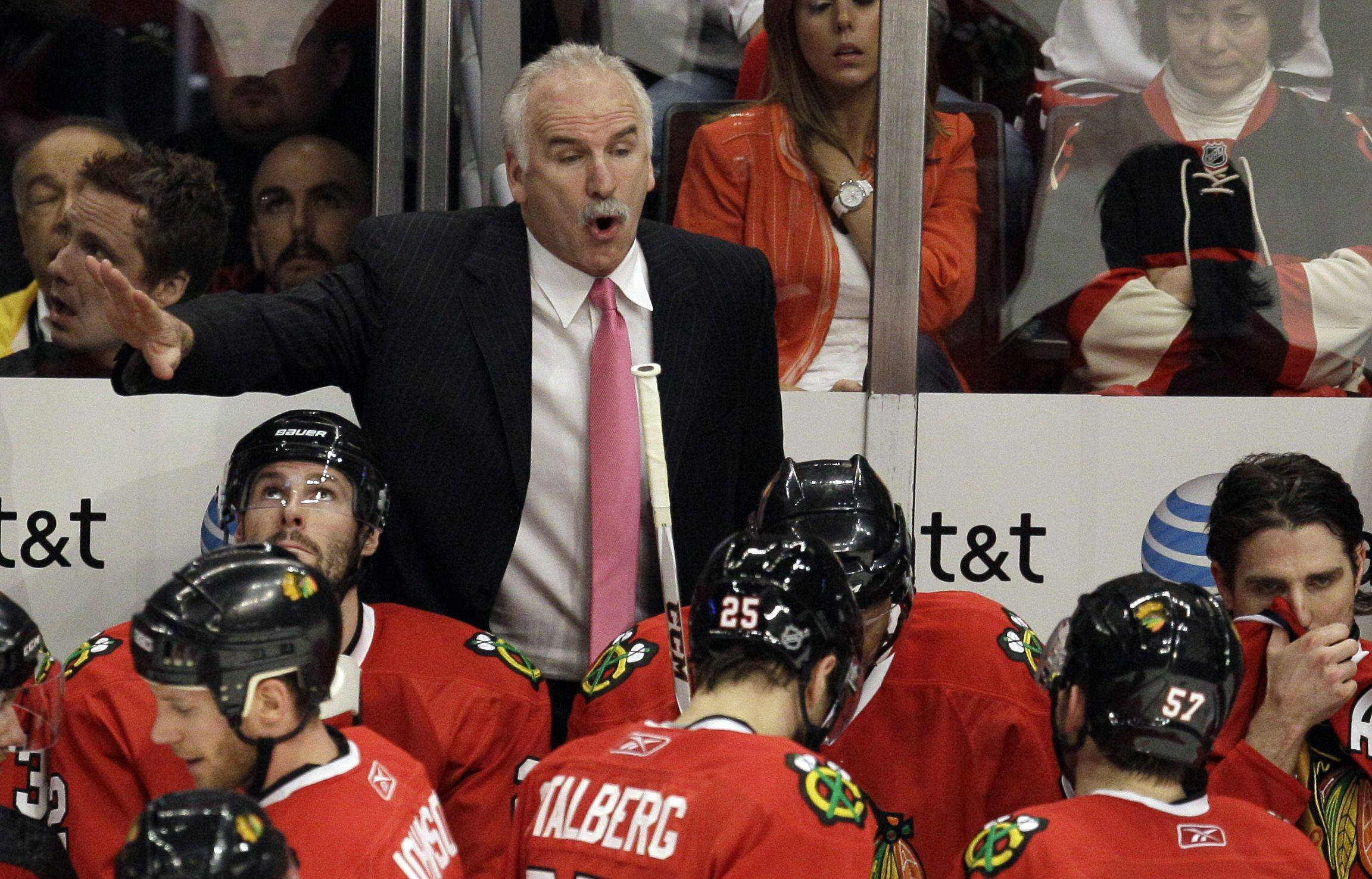 Chicago Blackhawks' Joel Quenneville directs his team during the overtime period.