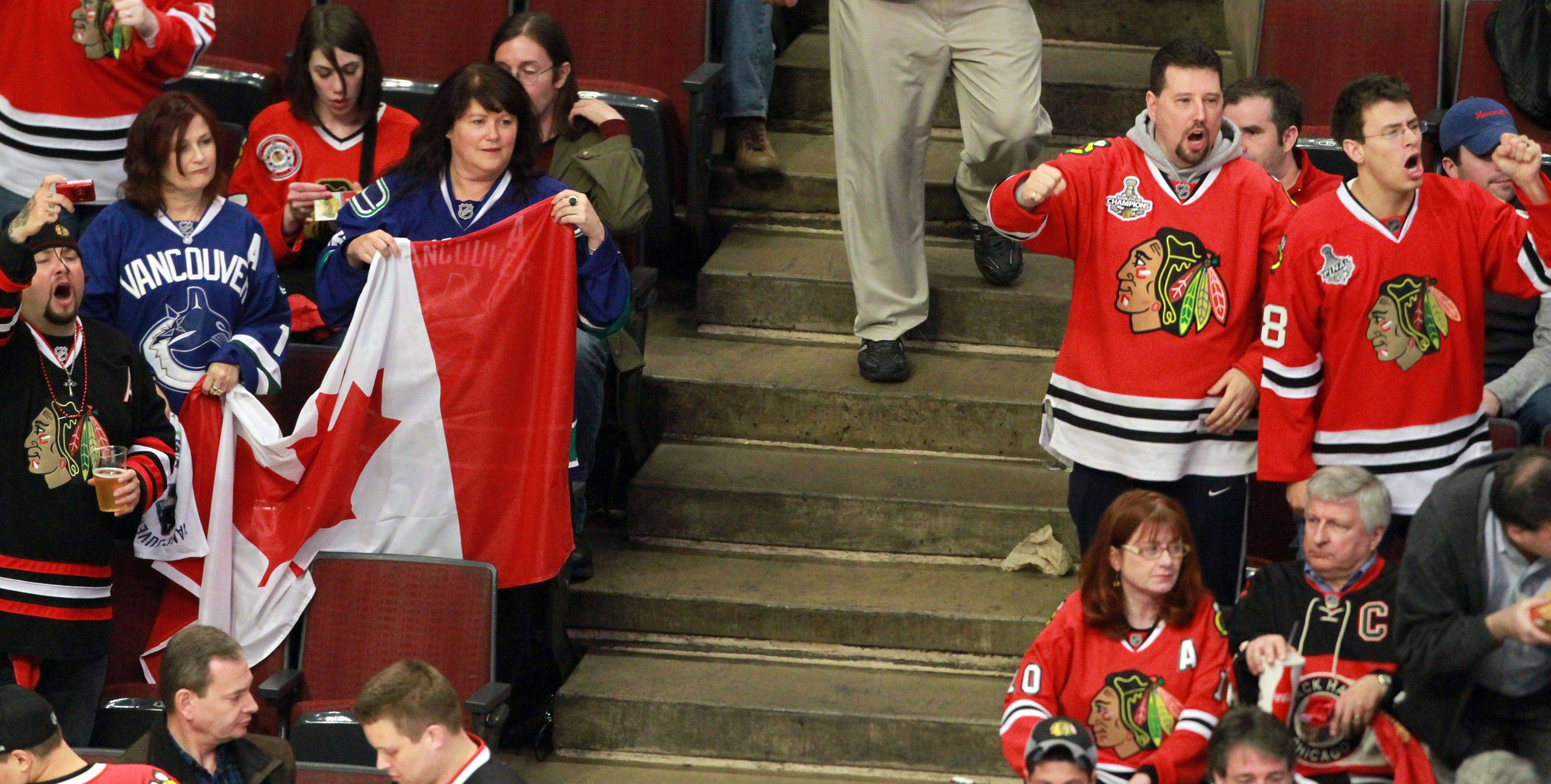 Chicago Blackhawks and Vancouver Canucks fans at game 6 of the Stanley Cup quarterfinals at the United Center in Chicago on Sunday.