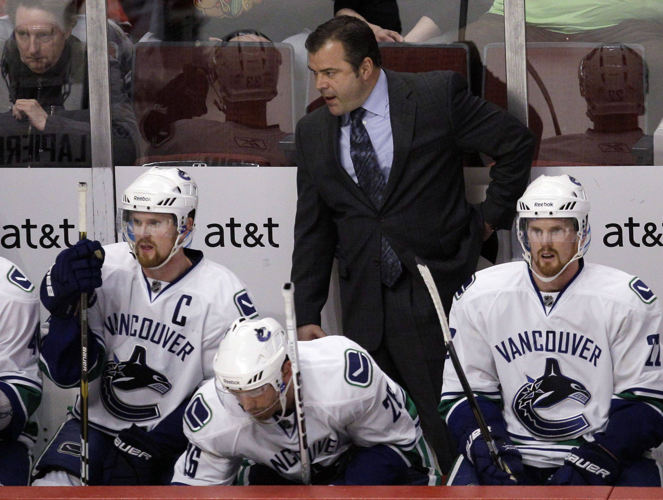 Vancouver Canucks head coach Alain Vigneault watches his team play against the Chicago Blackhawks during the overtime period.