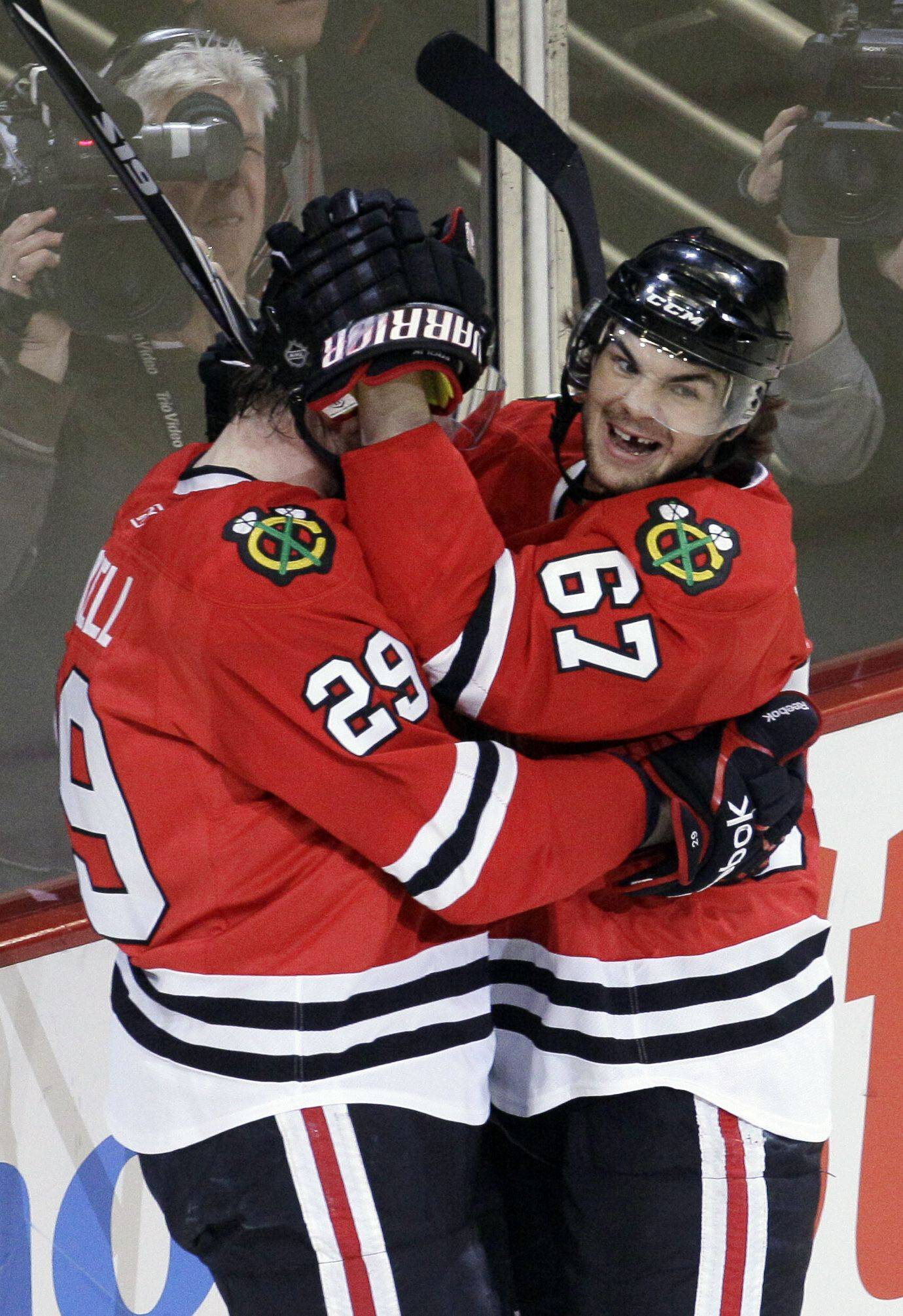 Chicago Blackhawks left wing Bryan Bickell celebrates his first period goal with center Michael Frolik.
