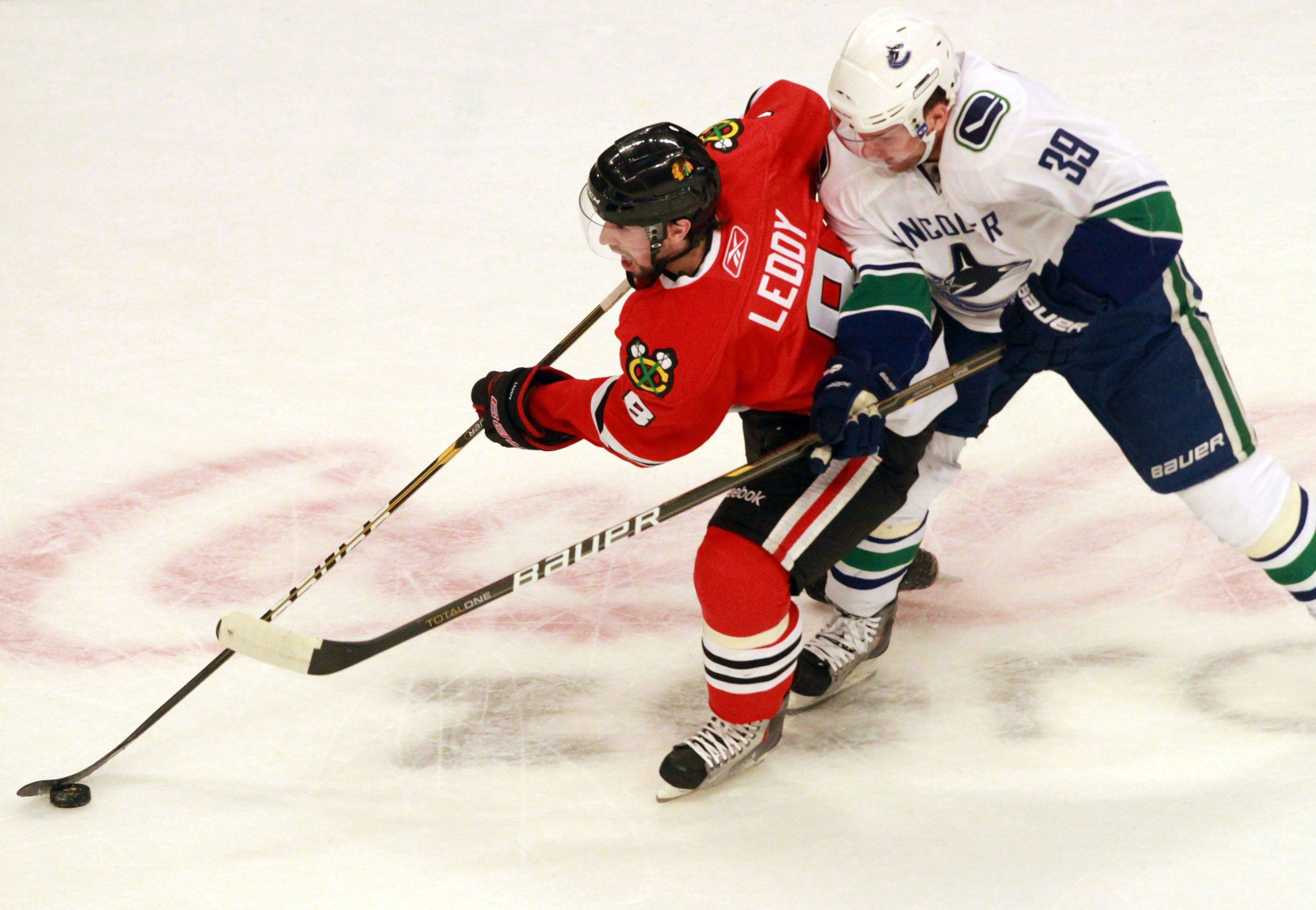 Chicago Blackhawks Nick Leddy blocks the puck from Vancouver Canucks Cody Hodgson in game 6 of the Stanley Cup quarterfinals at the United Center in Chicago on Sunday.
