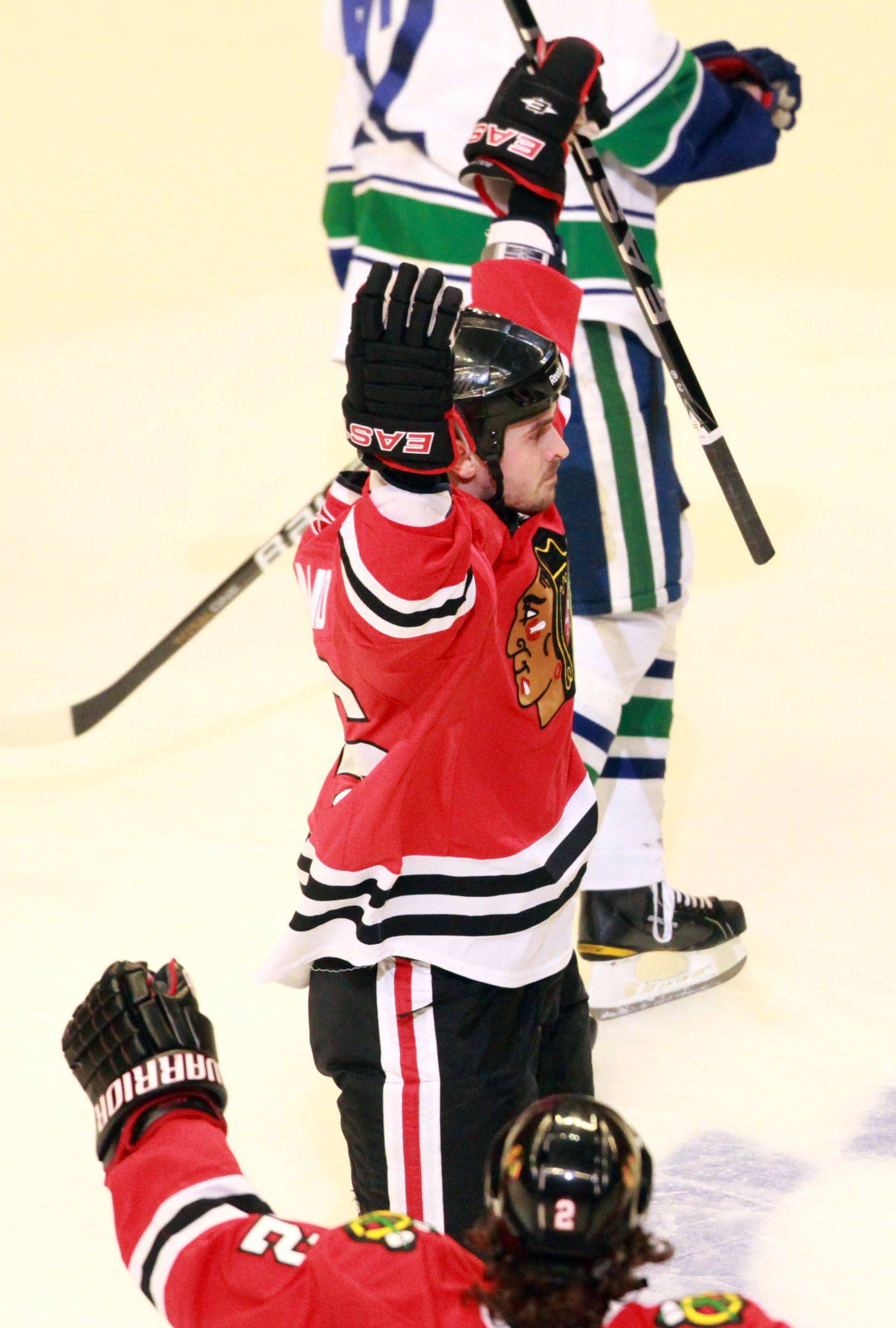Chicago Blackhawks Michael Frolik celebrates his penalty goal against Vancouver Canucks in game 6 of the Stanley Cup quarterfinals at the United Center in Chicago on Sunday.