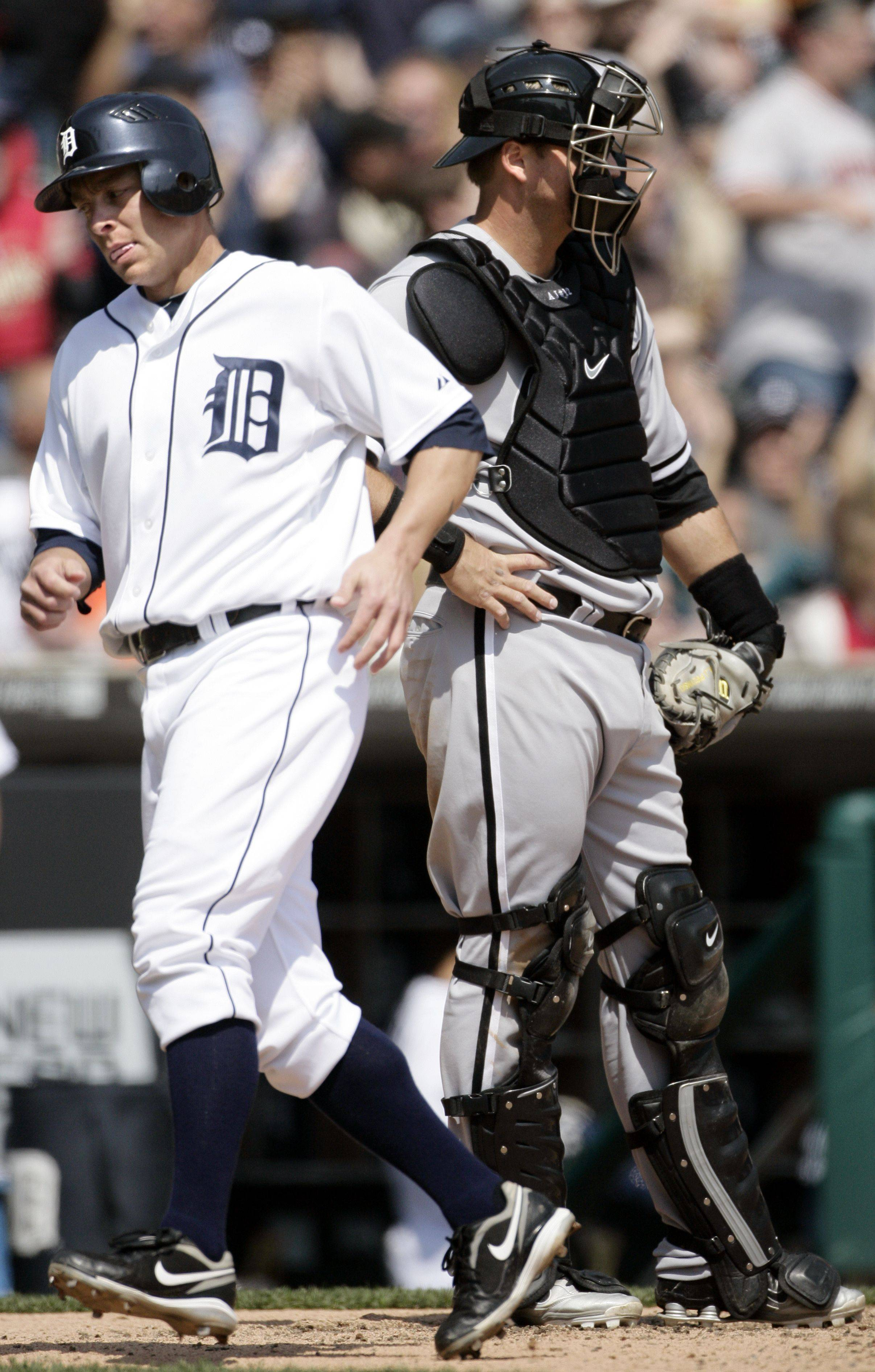 Detroit Tigers' Brandon Inge, left, scores from second base past Chicago White Sox catcher A.J. Pierzynski on a double by Austin Jackson in the sixth inning Sunday in Detroit.