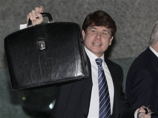 Former Illinois Gov. Rod Blagojevich arrives at federal court, briefcase in hand, as jury selection continues in his second corruption trial, Monday.