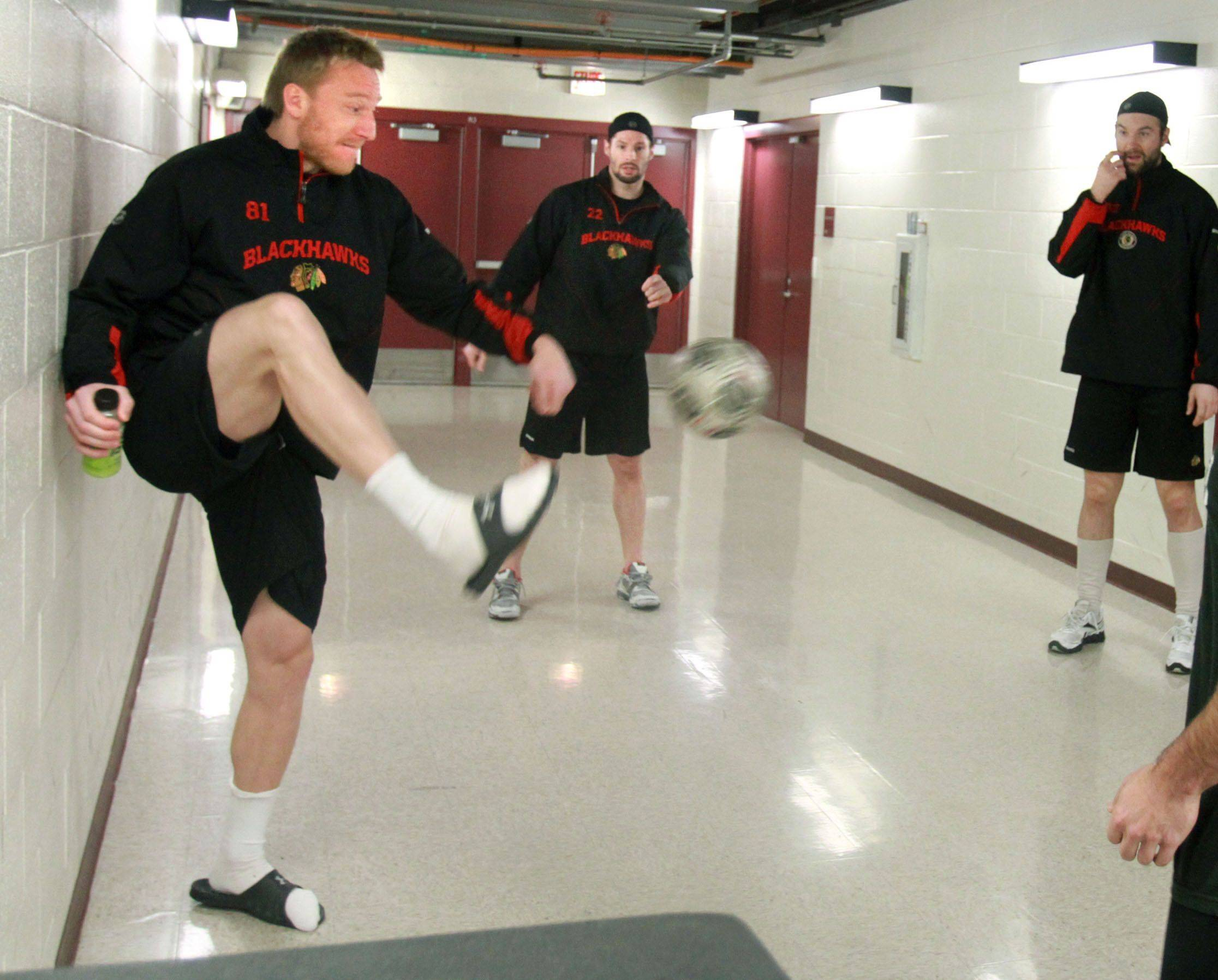 Marian Hossa kicks a soccer ball as Hawks players play a game of two-touch before facing the Vancouver Canucks in Game 6 of the Stanley Cup quarterfinals at the United Center on Sunday.