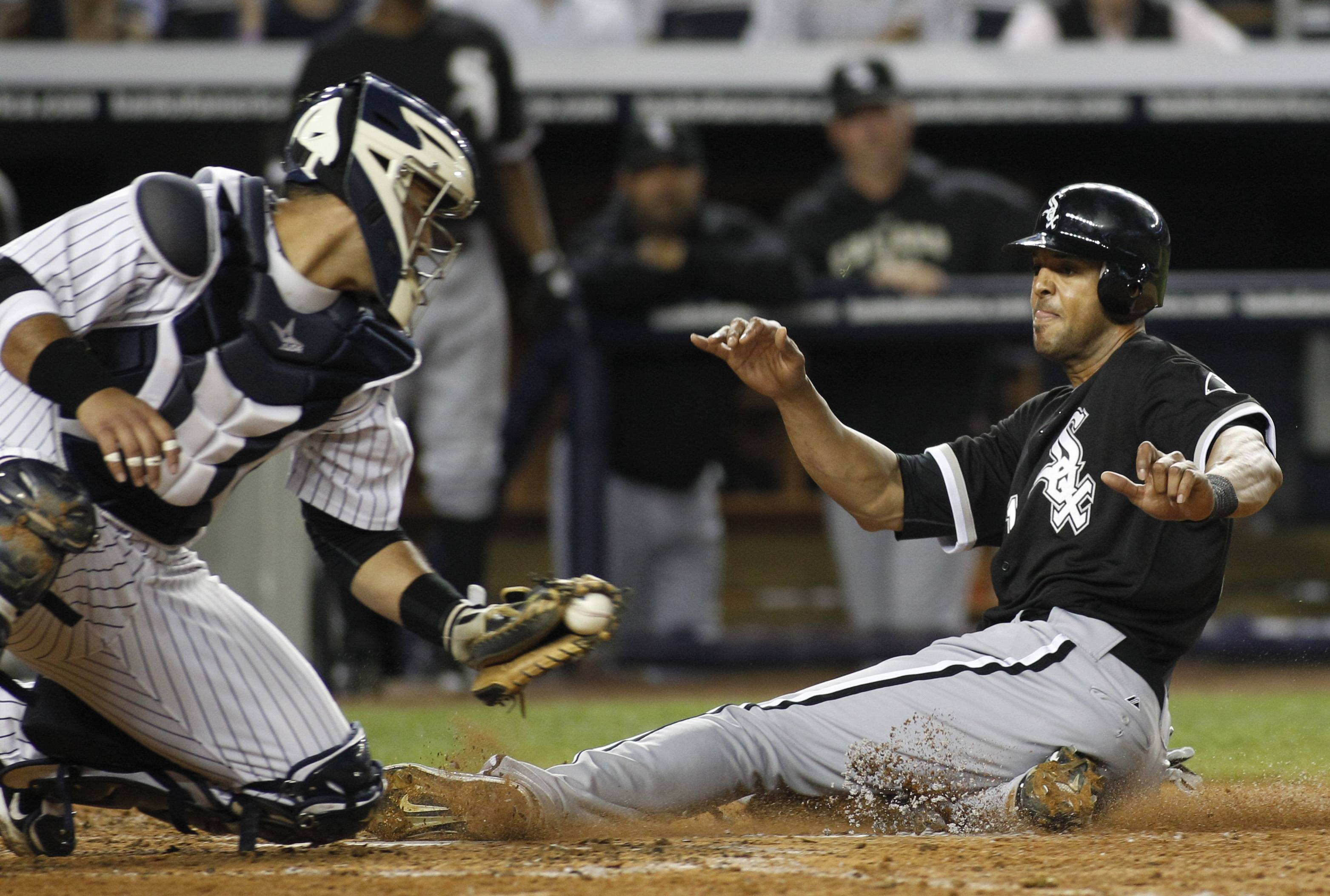New York Yankees catcher Gustavo Molina looks to make the tag as Chicago White Sox's Alex Rios scores in the fifth inning at Yankee Stadium on Tuesday.