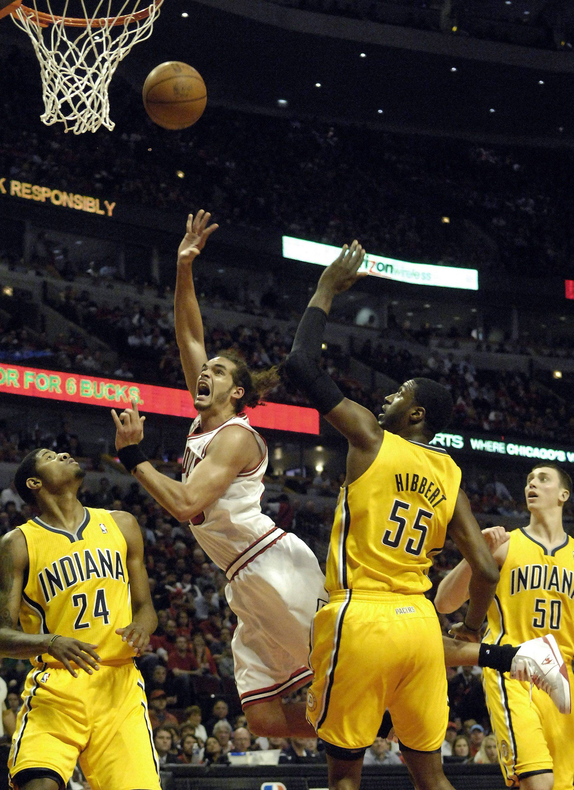 Joakim Noah puts up an off-balance shot in a lane full of Pacers during Game 5 Tuesday night at the United Center.