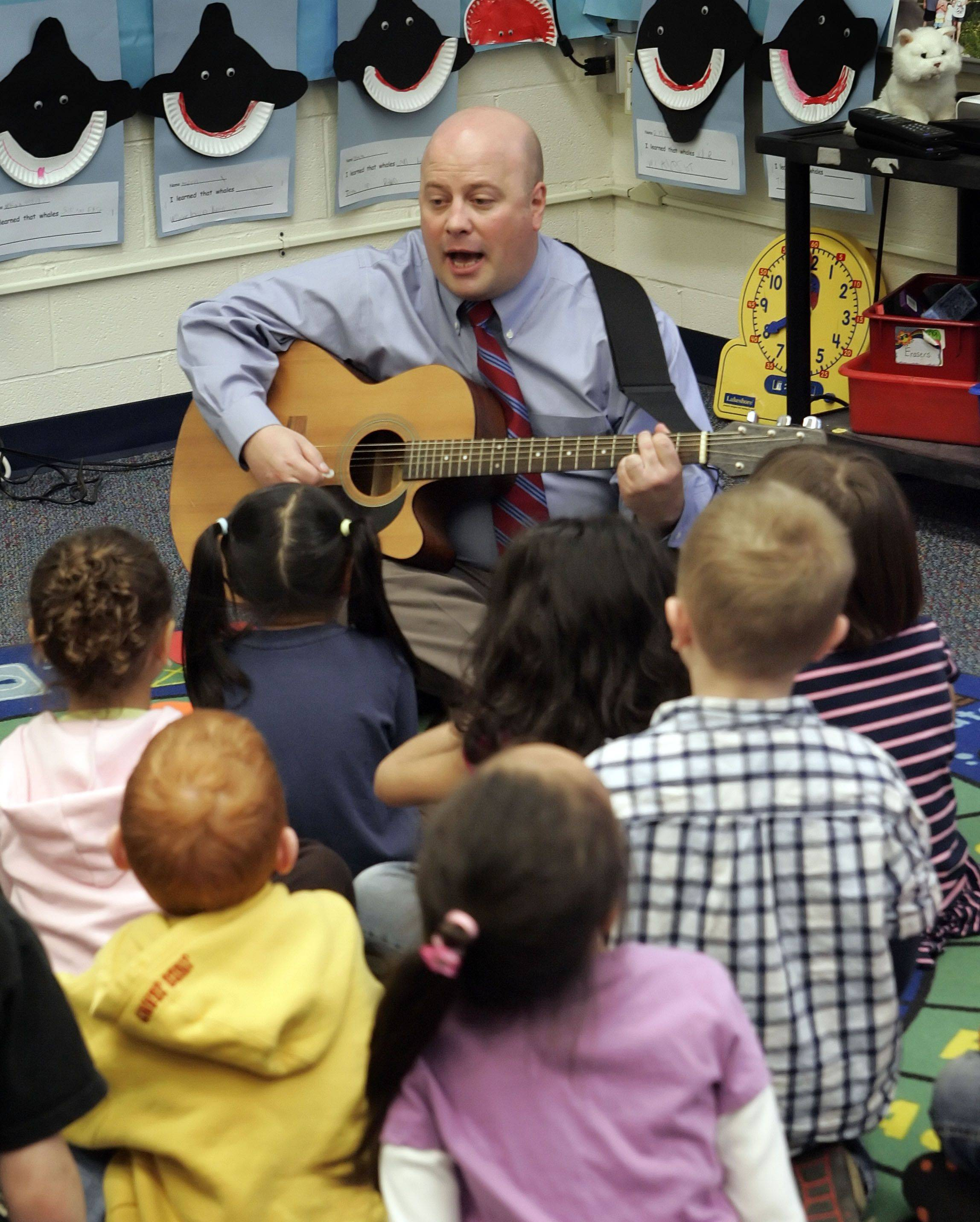 Adler Park School Principal Jon Bogie entertains the kindergarten class with his guitar in Libertyville. Bogie took over as principal this school year, replacing Janet Brownlie, who retired.